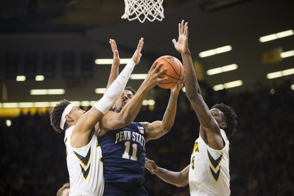 Penn State forward Lamar Stevens attempts a basket past Iowa forward Cordell Pemsl and forward Tyler Cook during an Iowa/Penn State mens basketball game in Carver-Hawkeye Arena on Saturday, Dec. 2, 2017. The Nittany Lions defeated the Hawkeyes, 77-73.