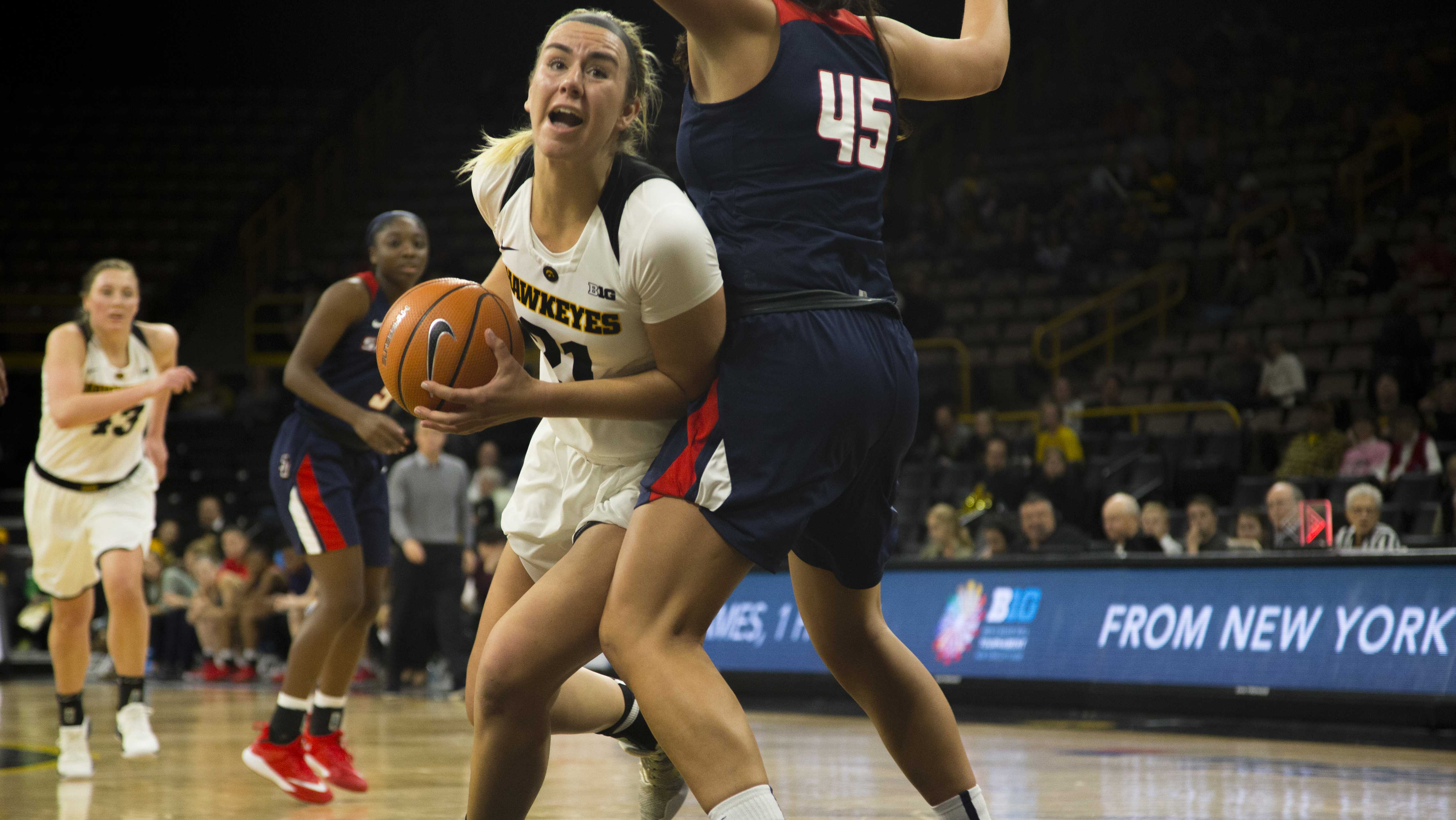 Iowa forward Hannah Stewart drives to the hoop during the Iowa/Samford basketball game at Carver-Hawkeye Arena on Sunday, Dec. 3, 2017. The Hawkeyes defeated the Bulldogs, 80-59. (Lily Smith/The Daily Iowan)