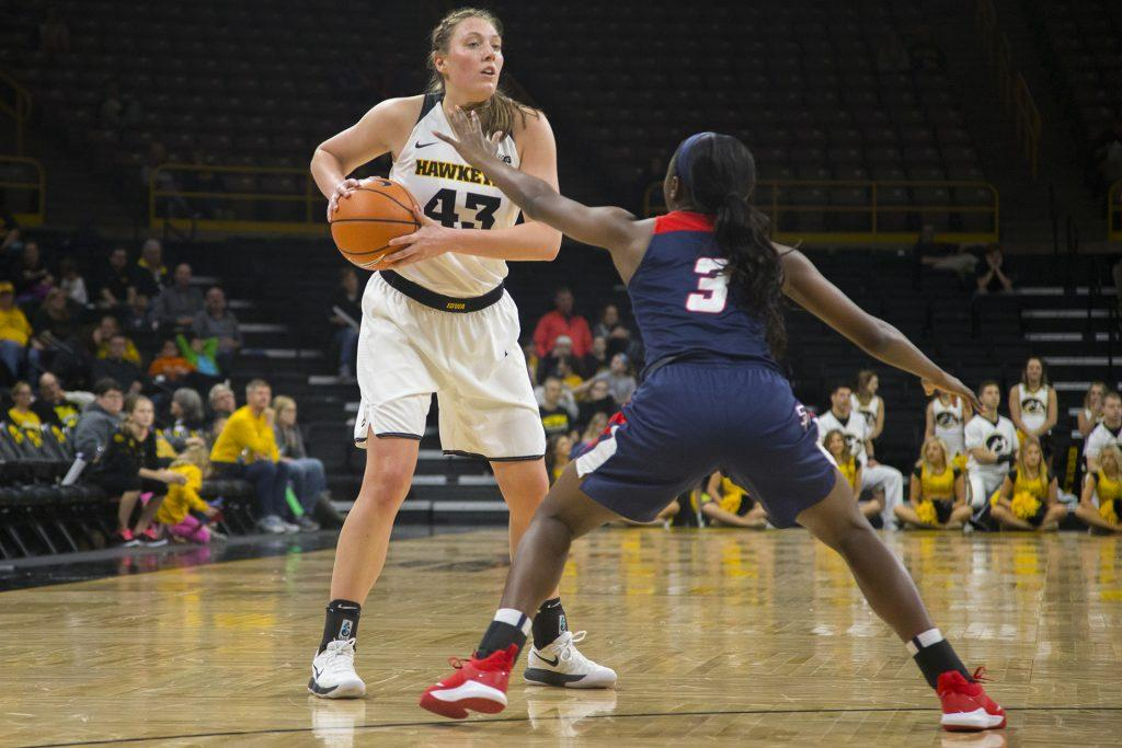 Iowa+forward+Amanda+Ollinger+guards+the+ball+from+Samford+guard+Shauntai+Battle+during+the+Iowa%2FSamford+basketball+game+at+Carver-Hawkeye+Arena+on+Sunday%2C+Dec.+3%2C+2017.+The+Hawkeyes+defeated+the+Bulldogs%2C+80-59.+%28Lily+Smith%2FThe+Daily+Iowan%29