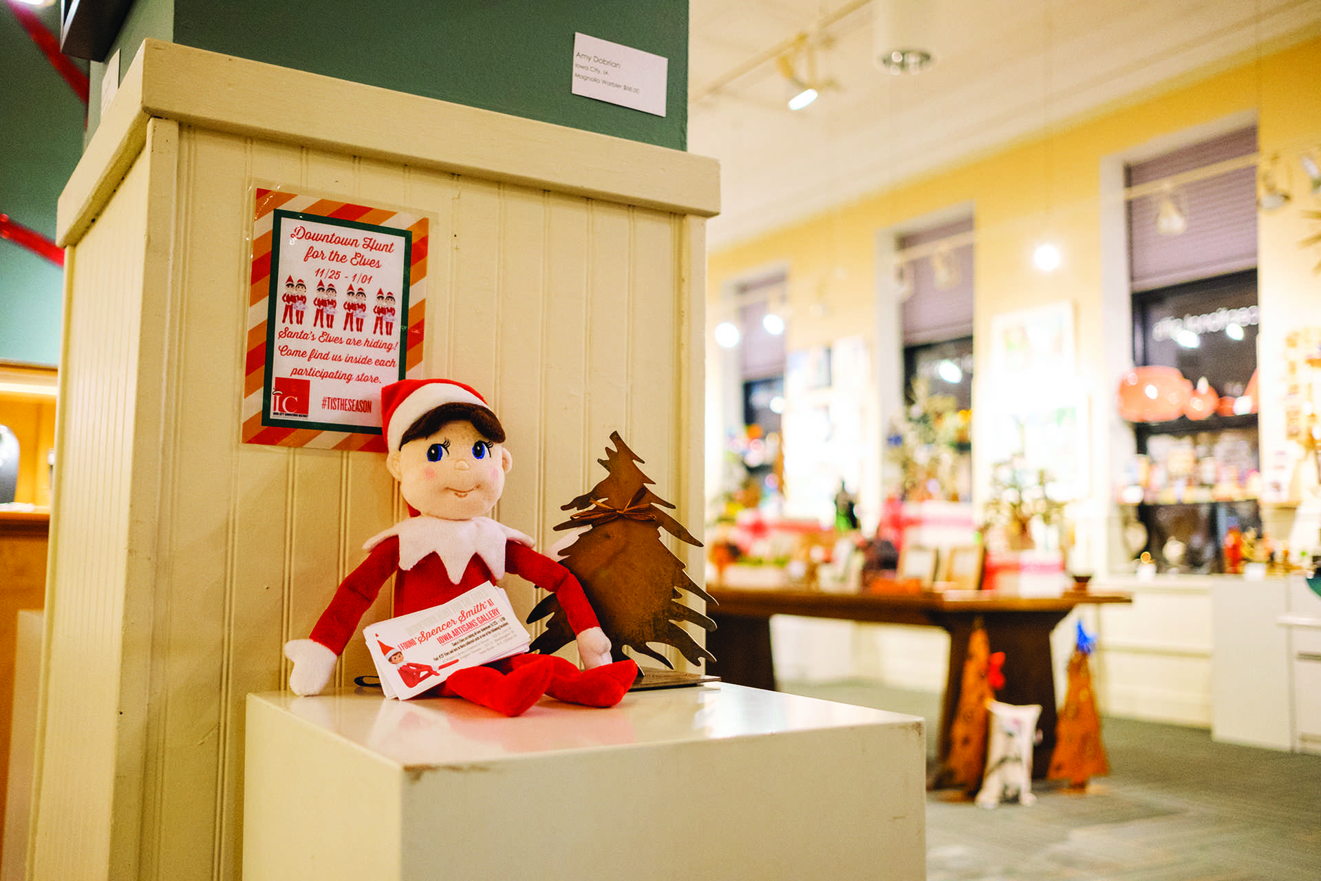Spencer Smith the elf is seen at the Iowa Artisans Gallery in Iowa City on Monday, Dec. 4, 2017. The Iowa City Downtown District has organized an elf scavenger hunt at downtown businesses. (Nick Rohlman/The Daily Iowan)