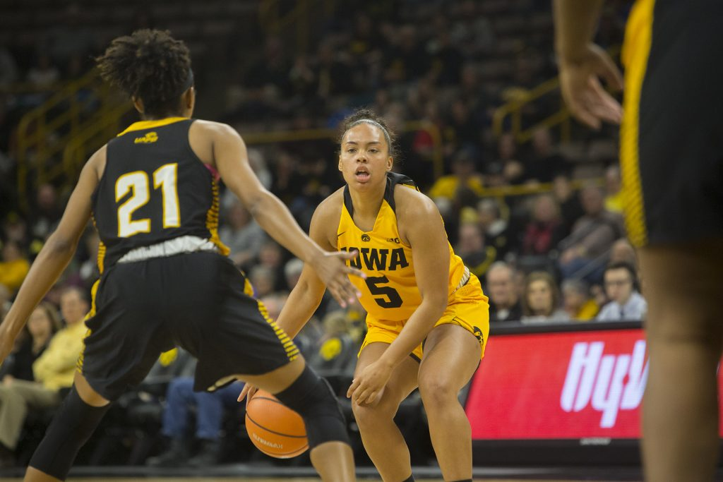 Iowa+guard+Alexis+Sevillian+dribbles+the+ball+during+the+Iowa%2FArkansas-Pine+Bluff+basketball+game+in+Carver-Hawkeye+Arena+on+Saturday%2C+Dec.+9%2C+2017.+The+Hawkeyes+defeated+the+Golden+Lions%2C+85-45.+%28Lily+Smith%2FThe+Daily+Iowan%29