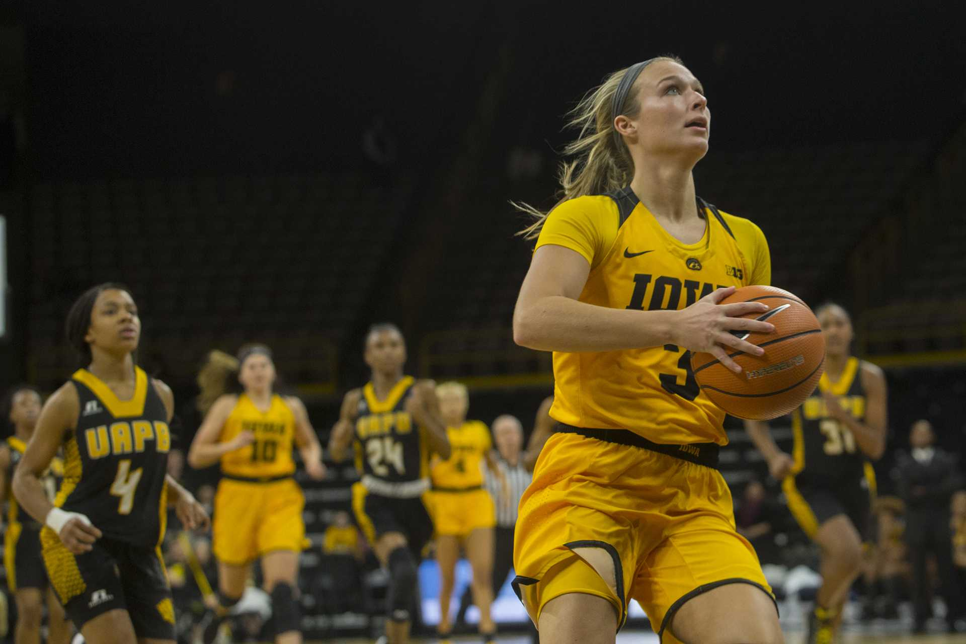 Iowa guard Makenzie Meyer looks to the hoop during the Iowa/Arkansas-Pine Bluff basketball game in Carver-Hawkeye Arena on Saturday, Dec. 9, 2017. The Hawkeyes defeated the Golden Lions, 85-45.