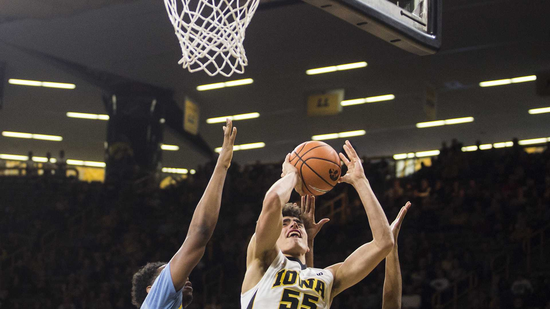 Iowa's Luka Garza (55) drives the ball for a layup during the game between Iowa and Southern at Carver-Hawkeye Arena on Sunday, Dec. 10. (Ben Allan Smith/The Daily Iowan)