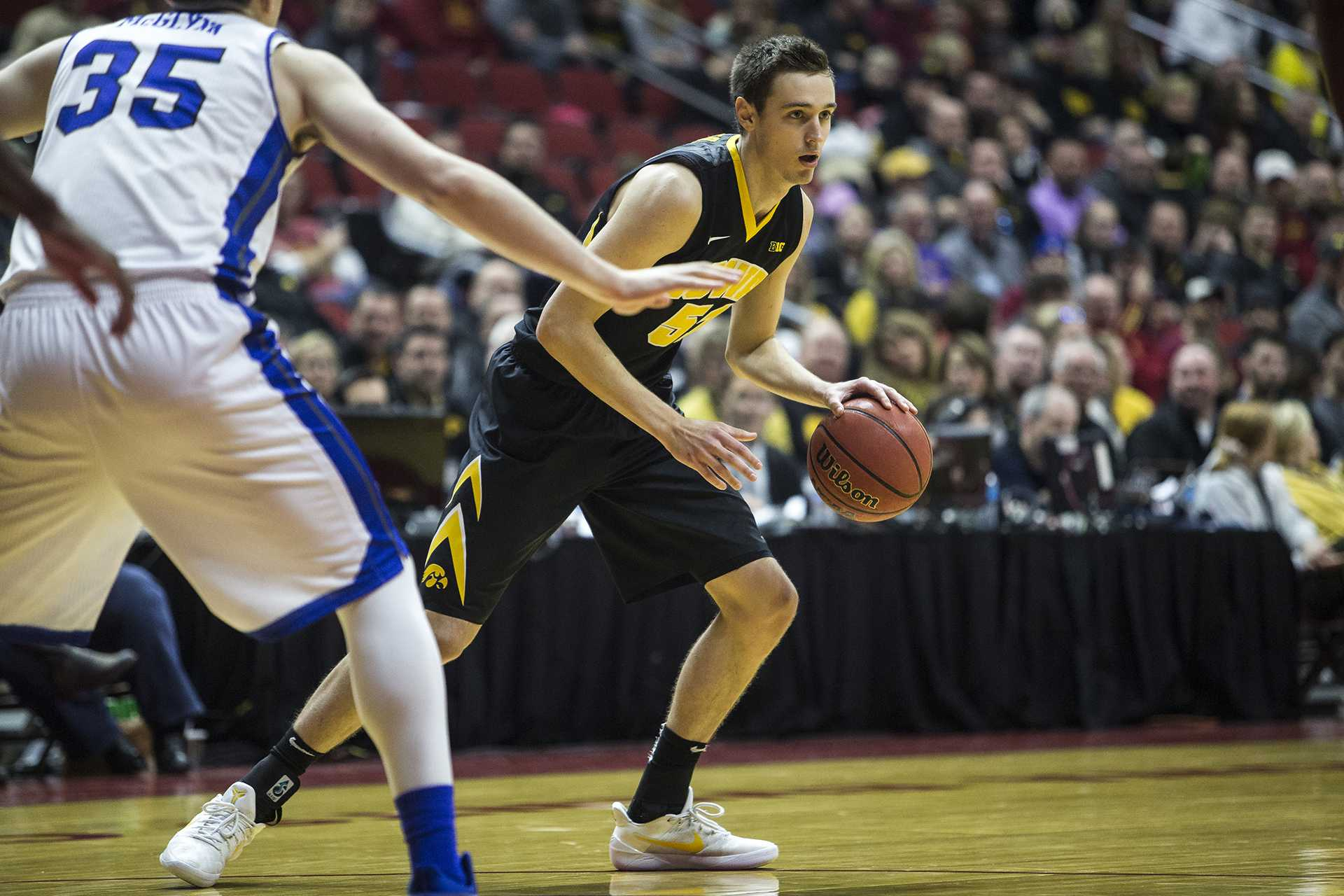 Iowa's Nicholas Baer (51) looks for an open pass during the Hy-Vee Classic men's basketball tournament at Wells Fargo Arena in Des Moines on Saturday, Dec. 16, 2017. The Hawkeyes beat the Bulldogs 90-64. (Ben Allan Smith/The Daily Iowan)