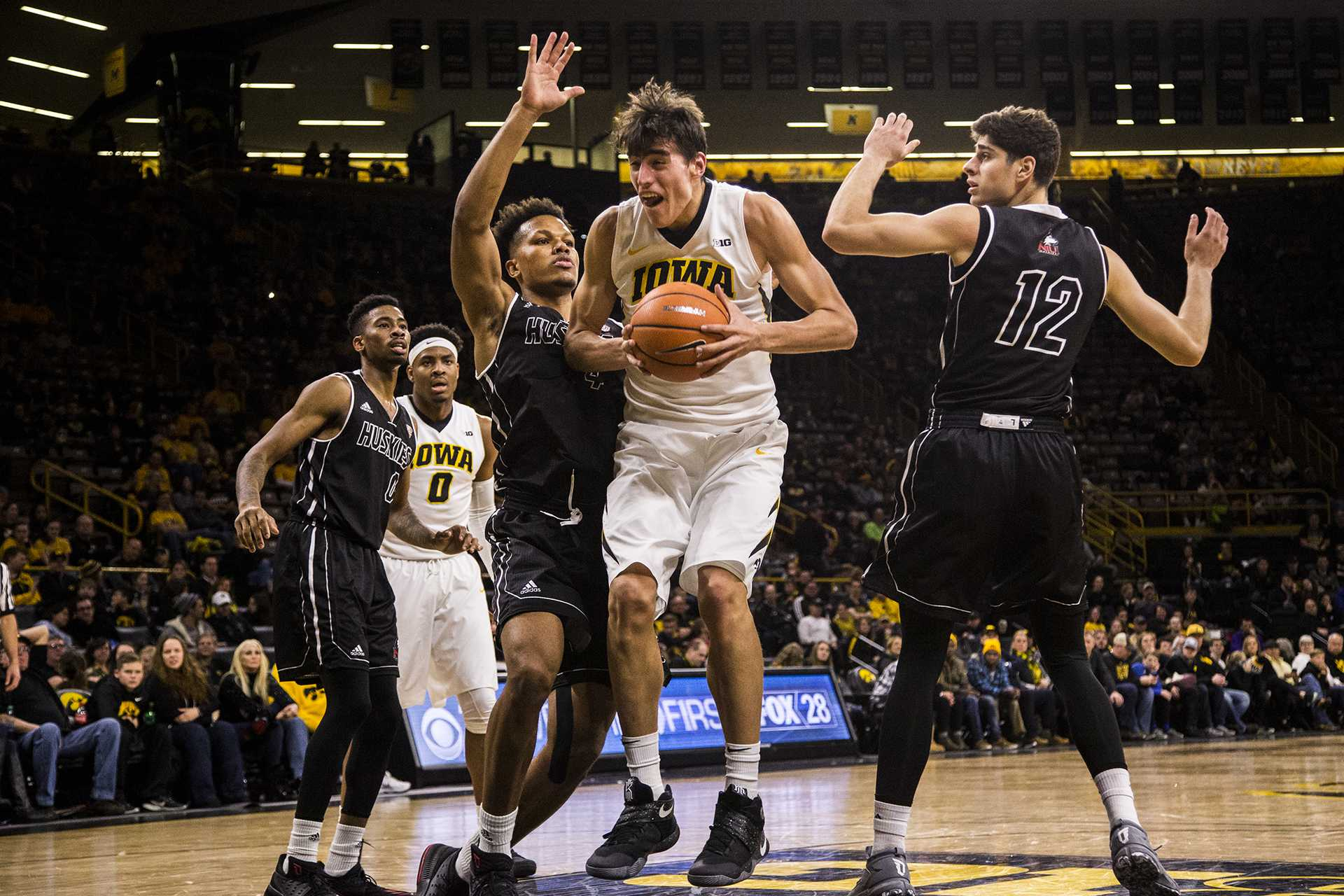 Iowa forward Luka Garza gathers the ball during Iowa's game against Northern Illinois on Friday Dec. 29, 2017. The Hawkeyes defeated the Huskies 98 to 75. (Nick Rohlman/The Daily Iowan)