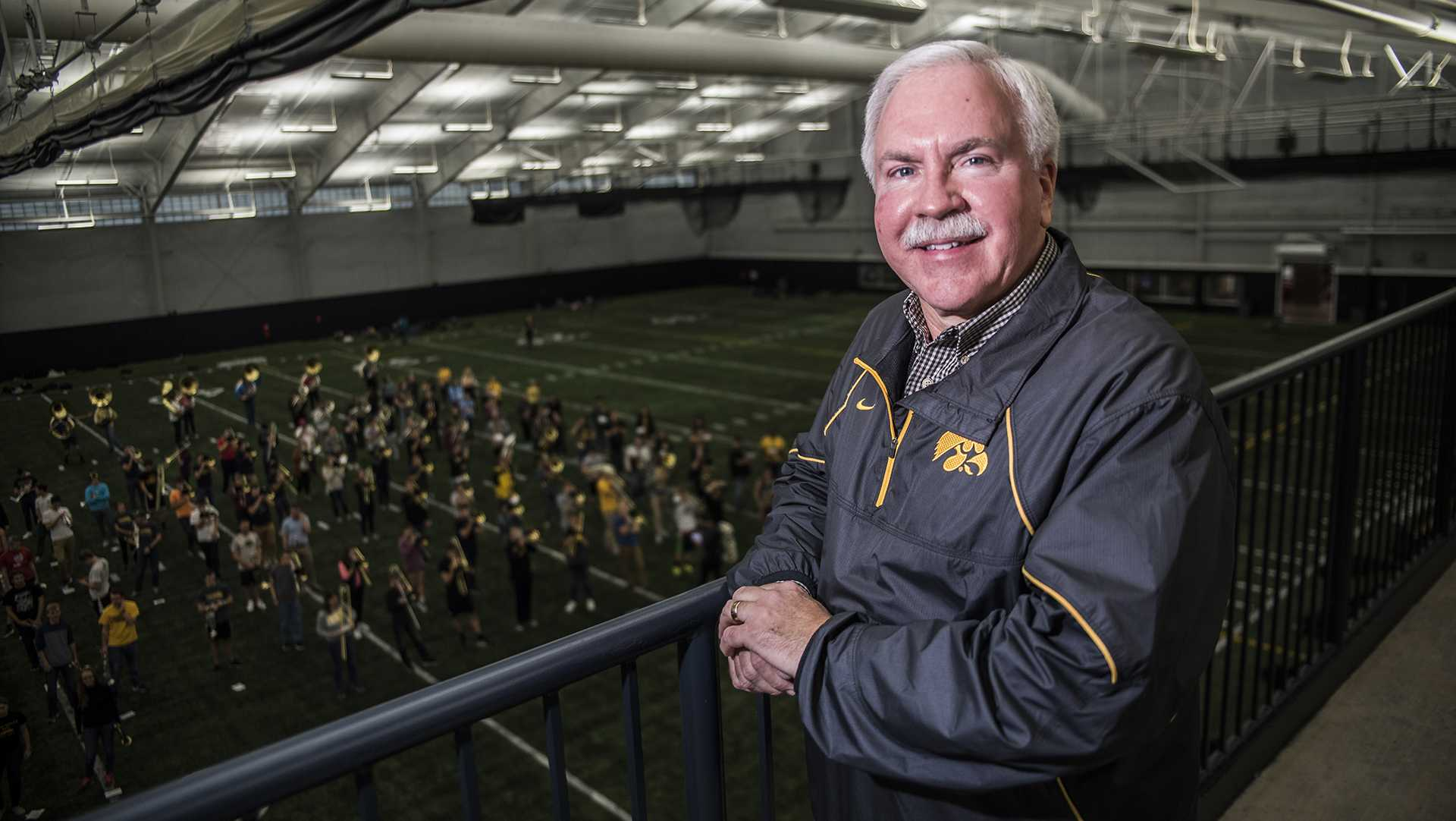 UI Marching Band Director Kevin Kastens poses for a portraits during practice at the Hawkeye Tennis and Recreation Center on Thursday, Nov. 16. Kastens is retiring this year after 20 years in multiple directorial positions at the University. (Ben Smith/The Daily Iowan)