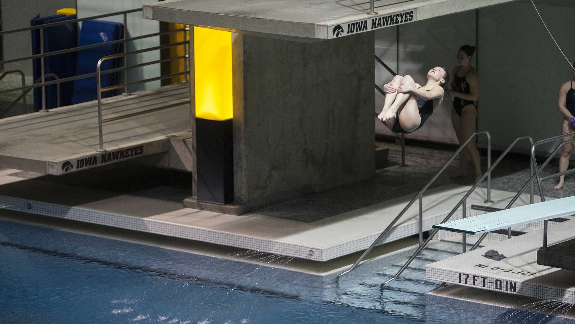 A diver competes in an event during a swimming and diving meet against Northern Iowa and Western Illinois on Friday, Feb. 3, 2017. The Hawkeyes defeated Northern Iowa, 147-73, and Western Illinois, 161-49. (The Daily Iowan/Joseph Cress)