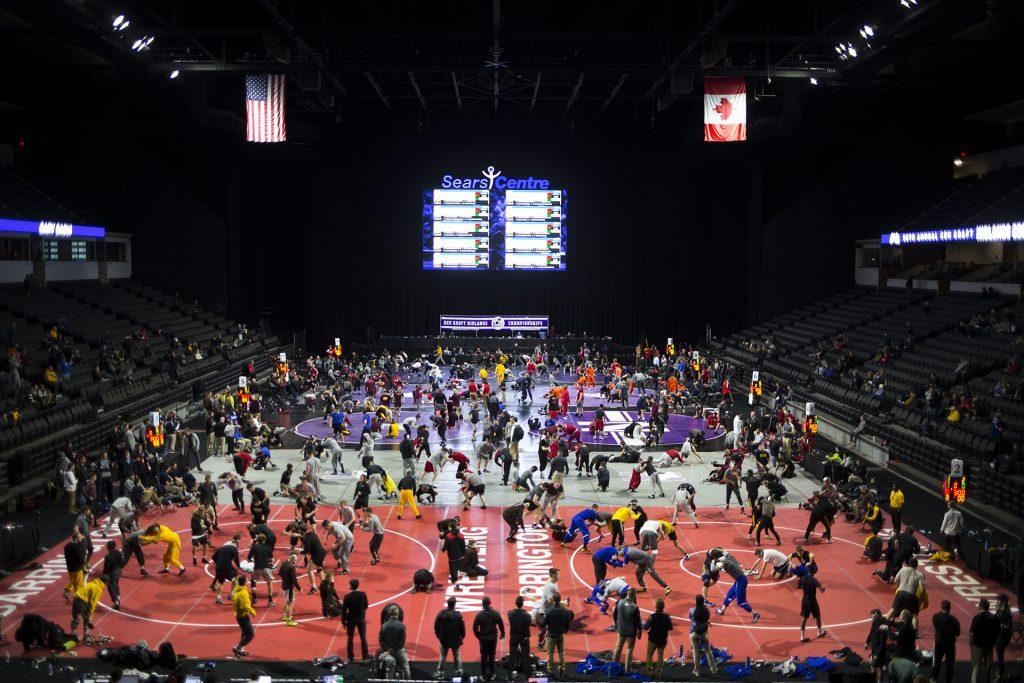 Mats+fill+up+with+wrestlers+while+they+warmup+before+the+first+session+of+the+55th+Annual+Midlands+Championships+in+the+Sears+Centre+in+Hoffman+Estates%2C+Illinois%2C+on+Friday%2C+Dec.+29%2C+2017.+%28Joseph+Cress%2FThe+Daily+Iowan%29