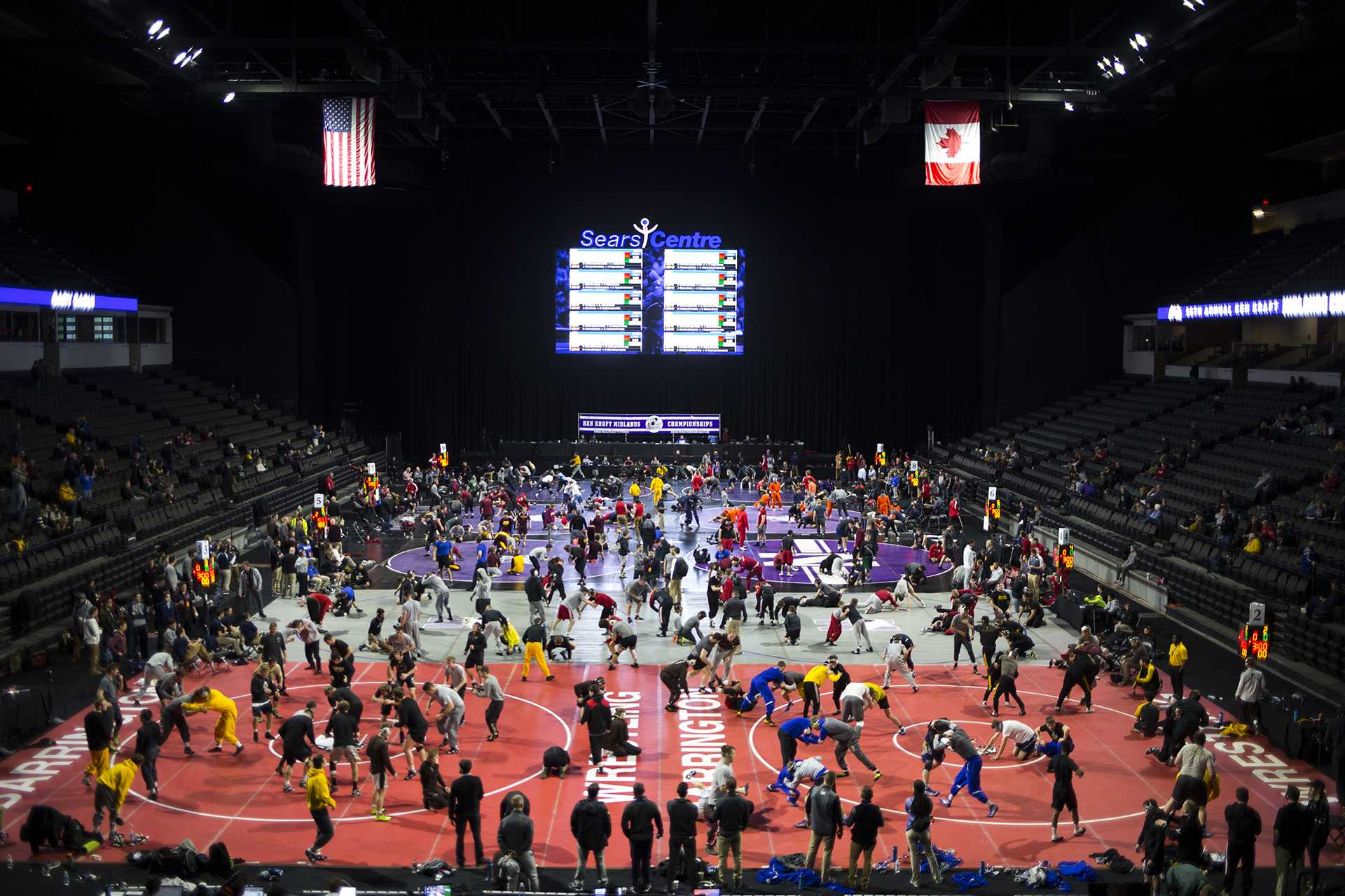 Mats fill up with wrestlers while they warmup before the first session of the 55th Annual Midlands Championships in the Sears Centre in Hoffman Estates, Illinois, on Friday, Dec. 29, 2017. (Joseph Cress/The Daily Iowan)
