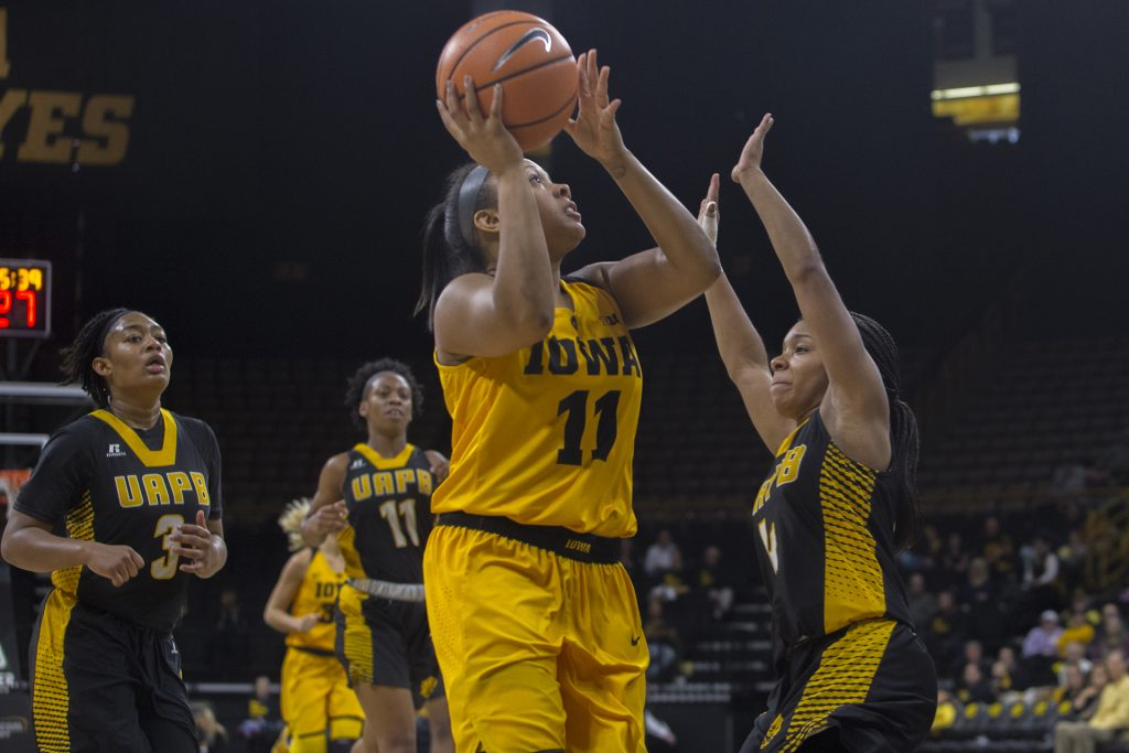 Iowa+guard+Tania+Davis+attempts+a+shot+during+the+Iowa%2FArkansas-Pine+Bluff+basketball+game+in+Carver-Hawkeye+Arena+on+Saturday%2C+Dec.+9%2C+2017.+The+Hawkeyes+defeated+the+Golden+Lions%2C+85-45.+%28Lily+Smith%2FThe+Daily+Iowan%29