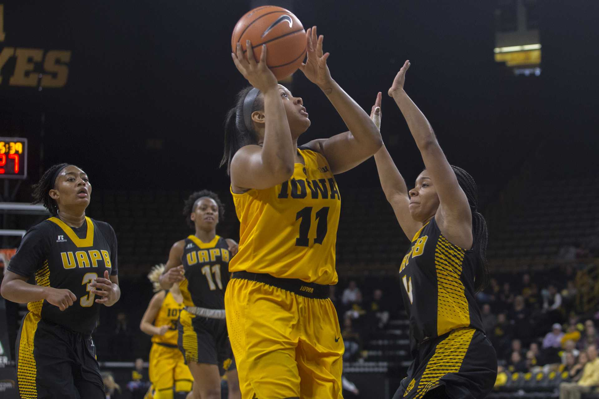 Iowa guard Tania Davis attempts a shot during the Iowa/Arkansas-Pine Bluff basketball game in Carver-Hawkeye Arena on Saturday, Dec. 9, 2017. The Hawkeyes defeated the Golden Lions, 85-45. (Lily Smith/The Daily Iowan)