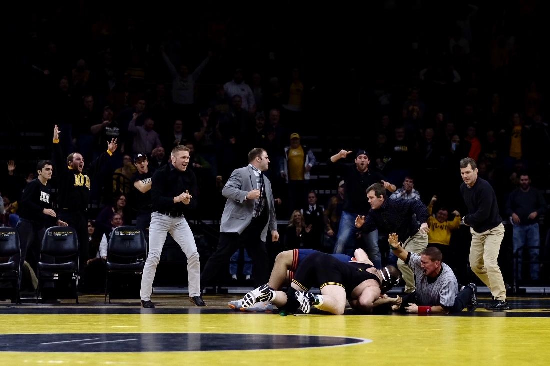 Iowa coaches react as Sam Stoll pins Illinois' Duece Rachal for the win during the Big Ten opener in Carver-Hawkeye Arena on Friday, Dec. 1, 2017. The Hawkeyes defeated the Illini 18-17. (Nick Rohlman/The Daily Iowan)