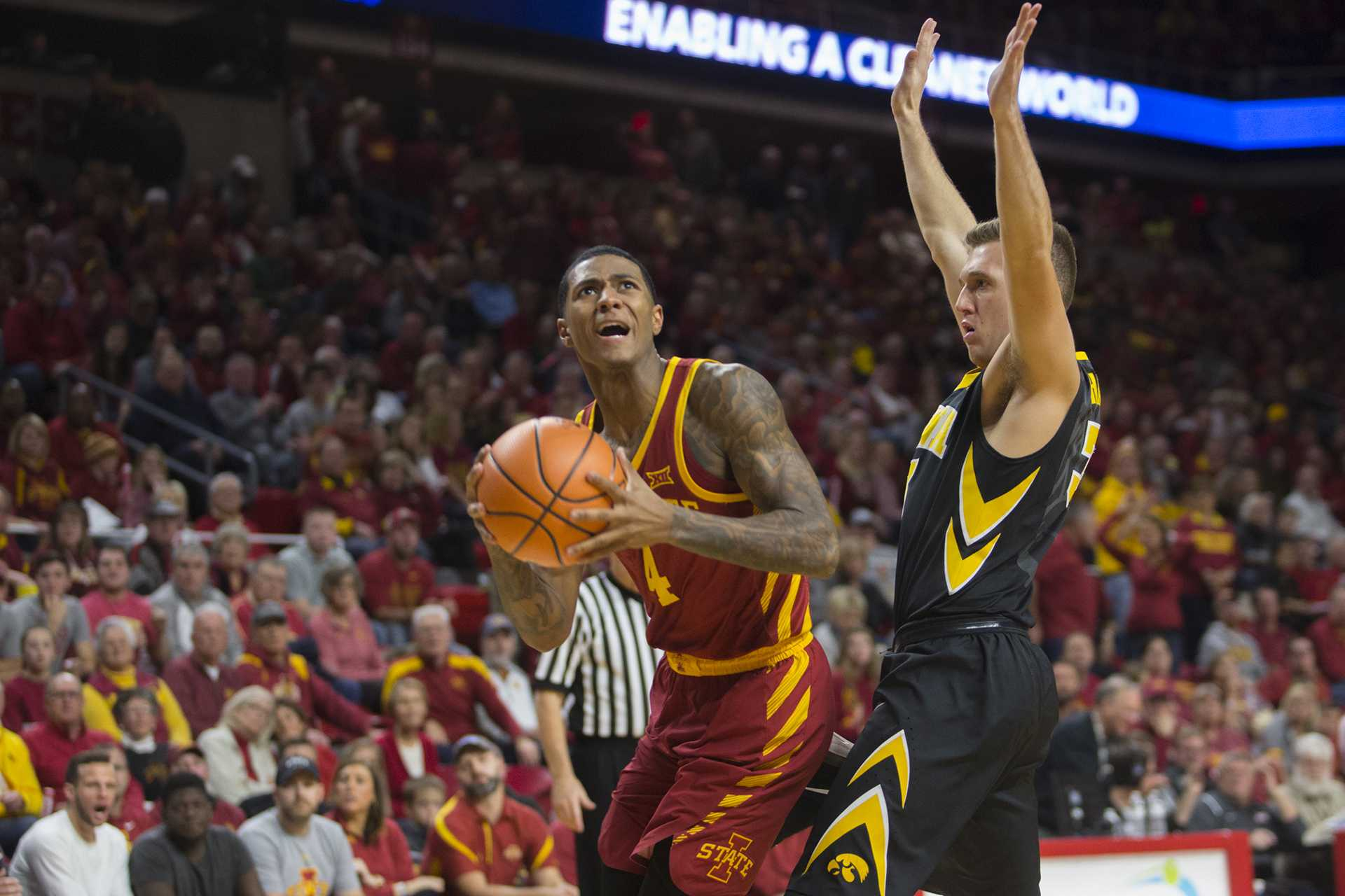 Iowa's Jordan Bohannon guards Iowa State's Donovan Jackson during the Iowa Corn CyHawk Series men's basketball game at Hilton Coliseum in Ames on Thursday, Dec. 7, 2017. The Cyclones defeated the Hawkeyes, 84-78. (Lily Smith/The Daily Iowan)