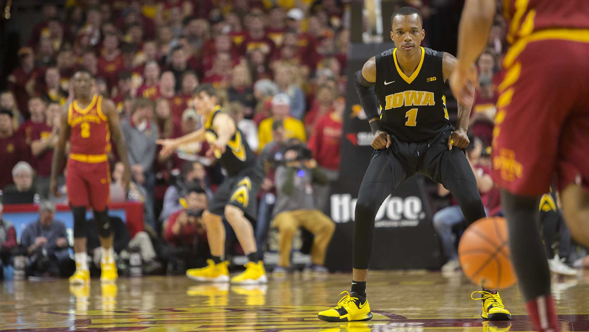 Iowa guard Maishe Dailey eyes an Iowa State player during the Iowa Corn CyHawk Series men's basketball game at Hilton Coliseum in Ames on Thursday, Dec. 7, 2017. The Cyclones defeated the Hawkeyes, 84-78. (Lily Smith/The Daily Iowan)