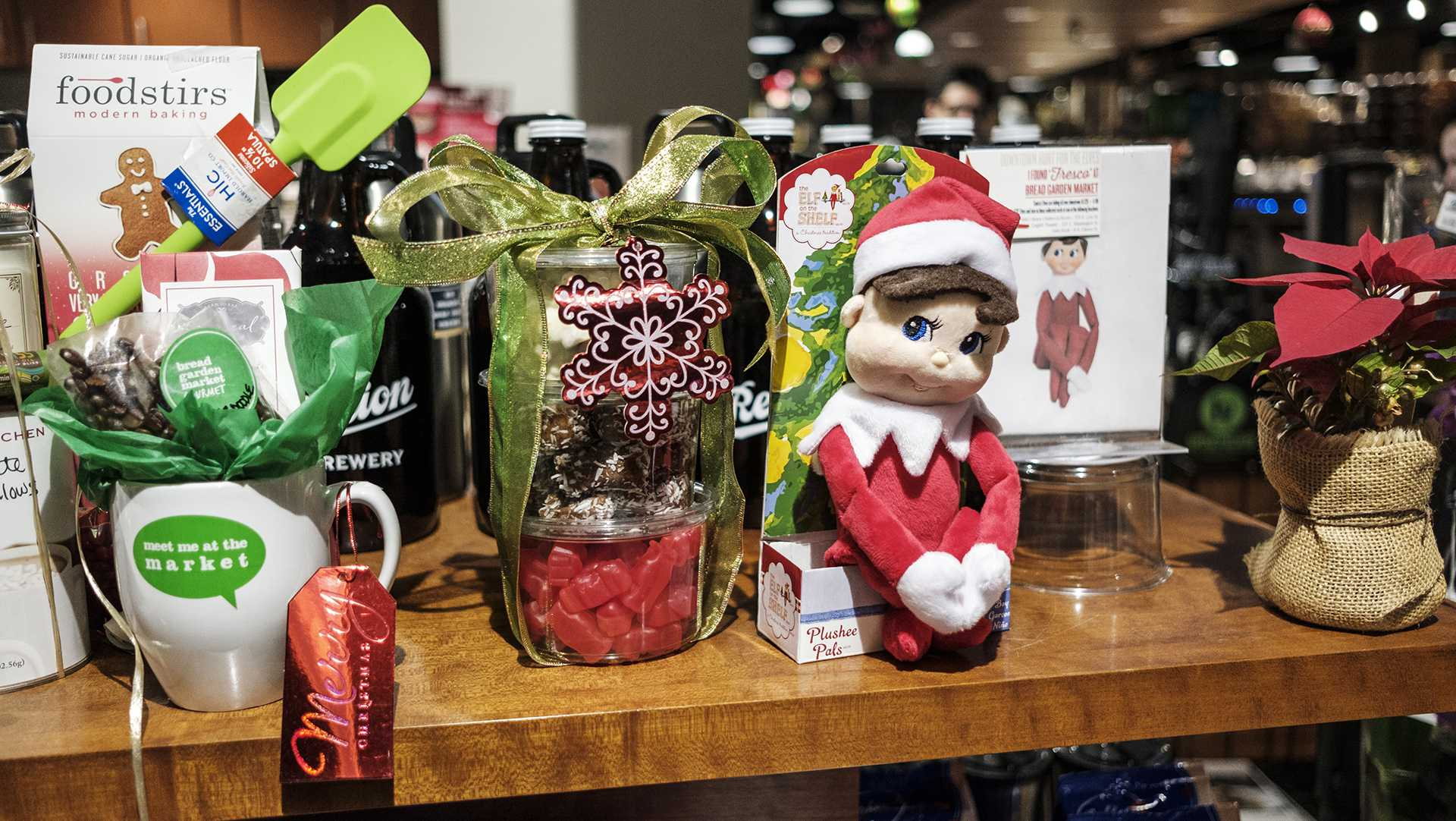 Fresco the elf is seen at Bread Garden in Iowa City on Monday, Dec. 4, 2017. The Iowa City Downtown District has organized an elf scavenger hunt at downtown businesses. (Nick Rohlman/The Daily Iowan)
