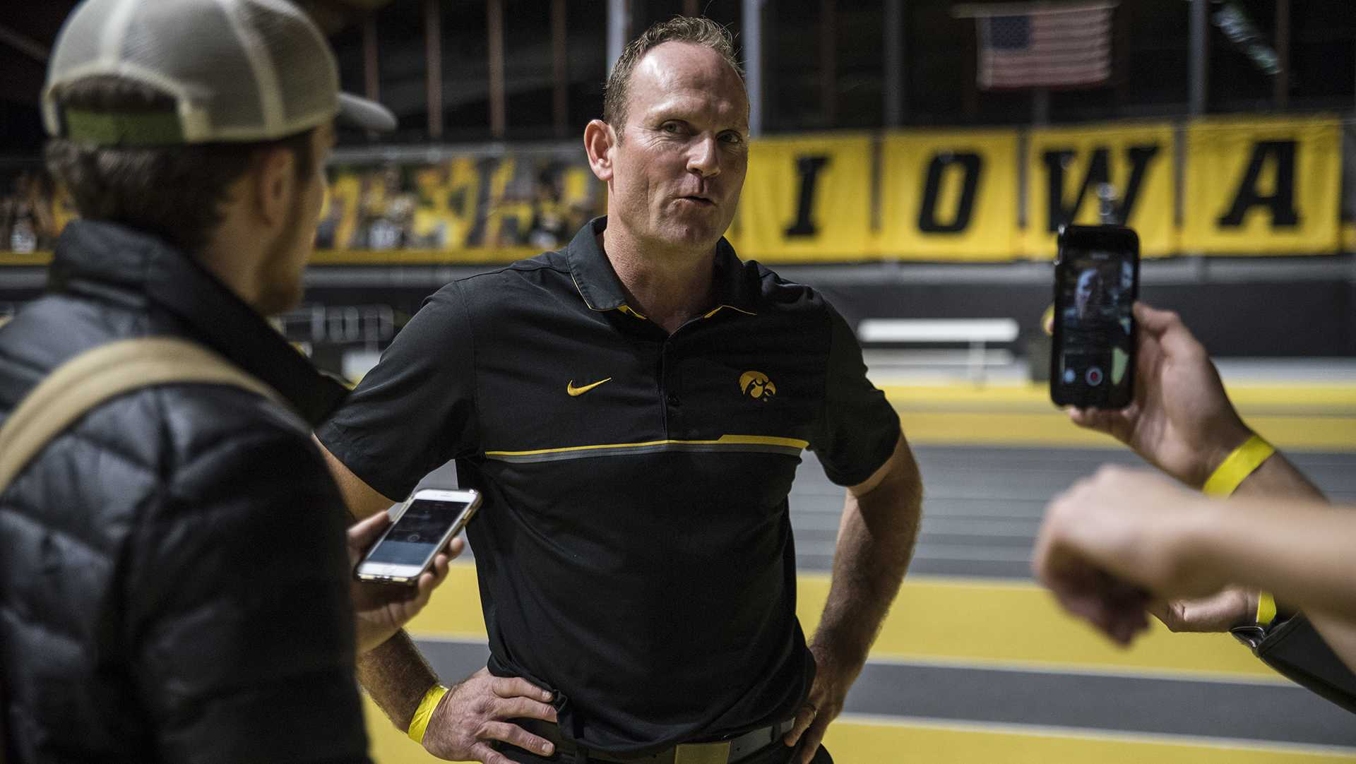 Iowa Director of Track and Field Joey Woody interviews with reporters after the annual Black and Gold Intrasquad Meet at the UI Recreation Building on Saturday, Dec. 9, 2017. The Hawkeyes will host the next meet on January 13. (Ben Allan Smith/The Daily Iowan)