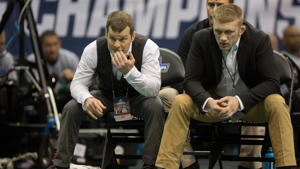 Iowas Head Coach Tom Brands watches from the corner during the 2017 NCAA Division I Wrestling Championships in the Scottrade Center in St. Louis, Missouri on Friday, March 17, 2017. Day two of the National Championships shrinks the number of competitors down to the final competition for the Championship match on Saturday. (The Daily Iowan/Anthony Vazquez)