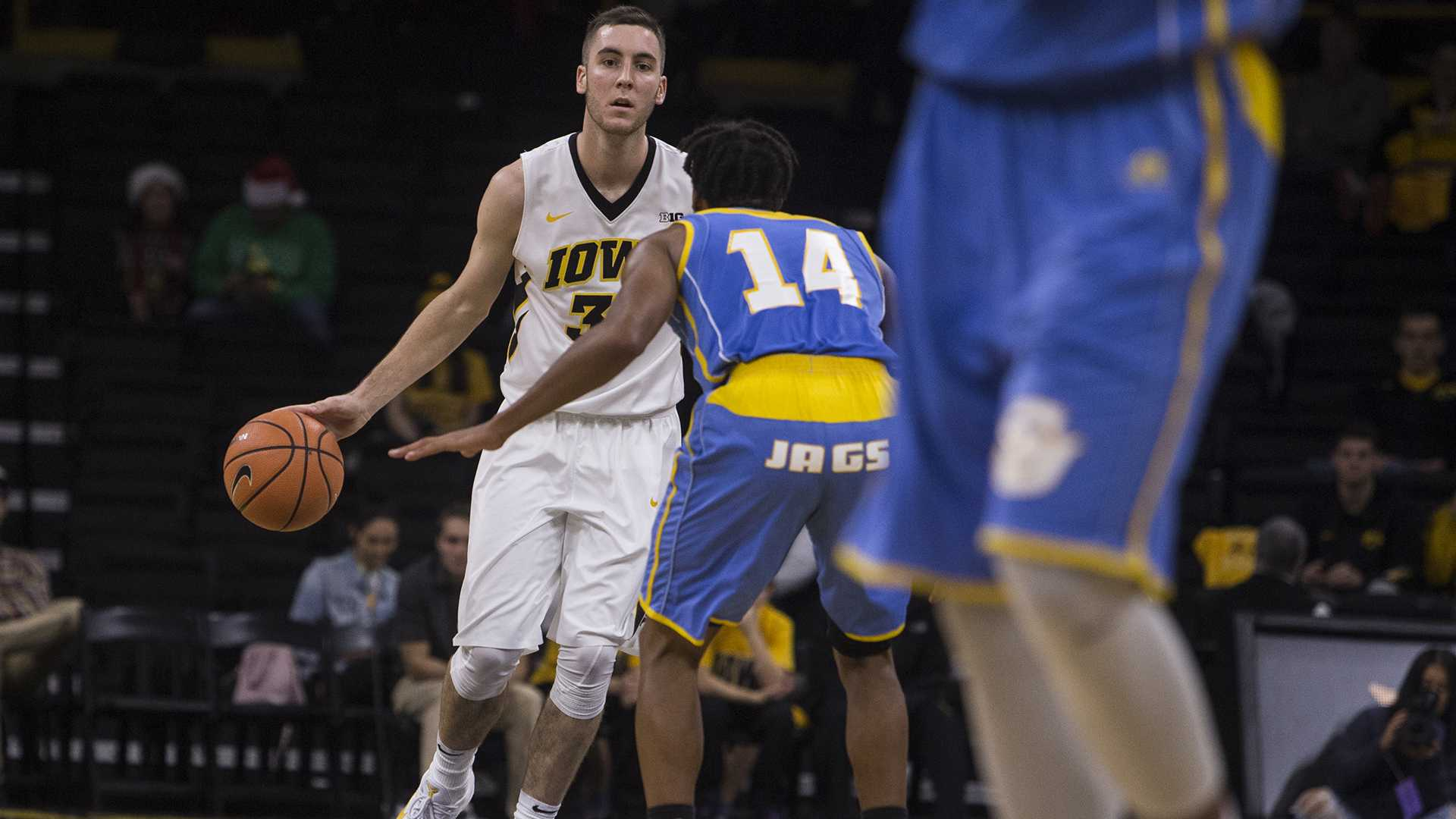 Iowa guard Connor McCaffery (30) looks for an open teammate during the game between Iowa and Southern at Carver-Hawkeye Arena on Sunday, Dec. 10. Iowa went on to defeat Southern 91-60. (Ben Allan Smith/The Daily Iowan)