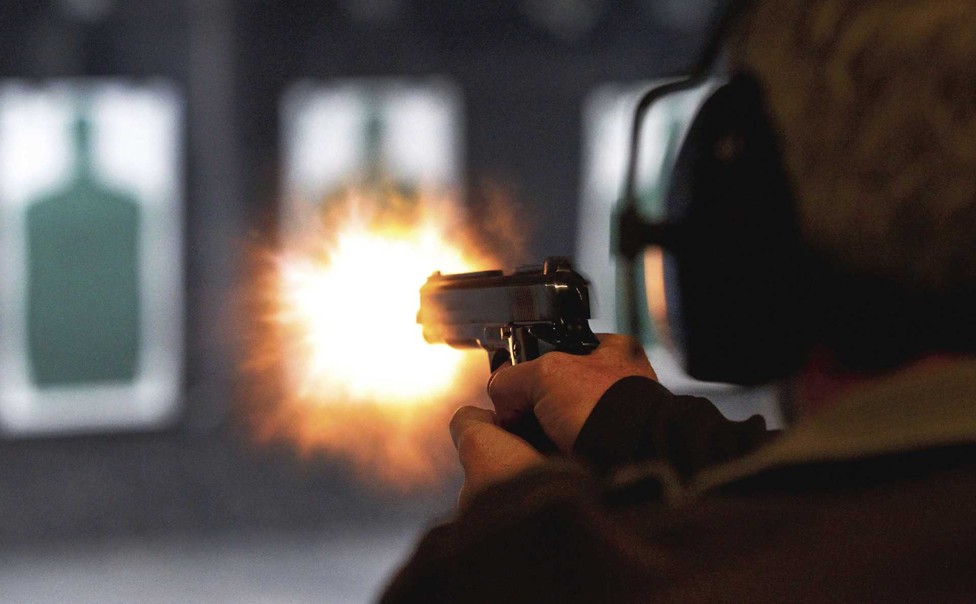 Ernie Vandergriff fires at a target during a class for a concealed handgun license at The Shooting Gallery in Fort Worth, Texas, January 17, 2013. (Ron Jenkins/Fort Worth Star-Telegram/MCT)