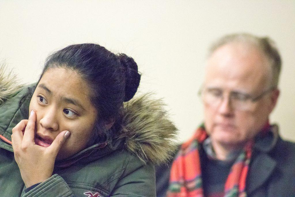 An audience member reacts at the Iowa City Public Library on Thursday, Dec. 14, 2017. The library hosted a presentation detailing immigration detention policies in eastern Iowa. (Shivansh Ahuja/The Daily Iowan)