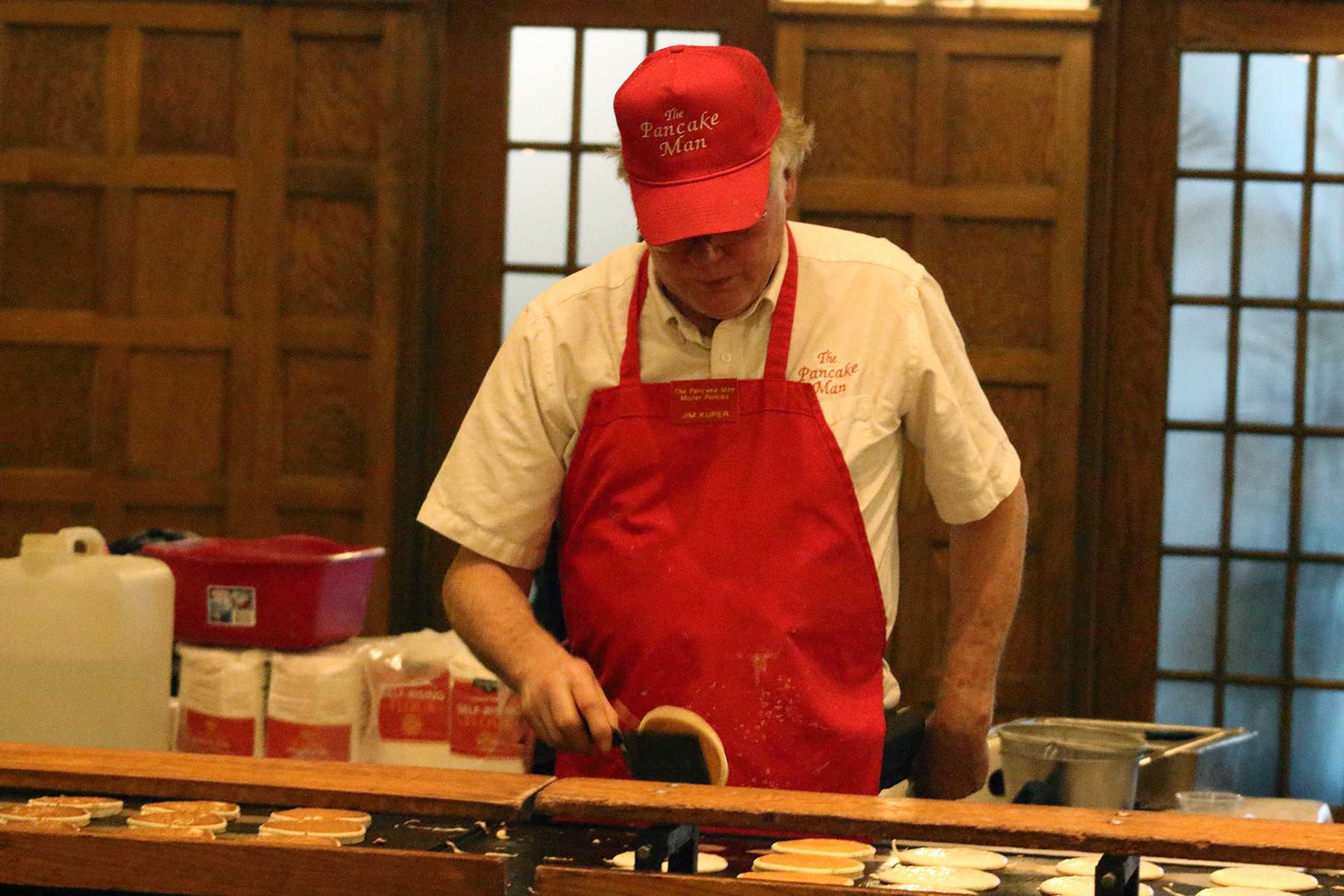 The Pancake Man flips hundreds of pancakes for students in the IMU on Monday, Dec. 11, 2017. The event was part of finals week events held to relieve the stress of students. (Ashley Morris/The Daily Iowan)