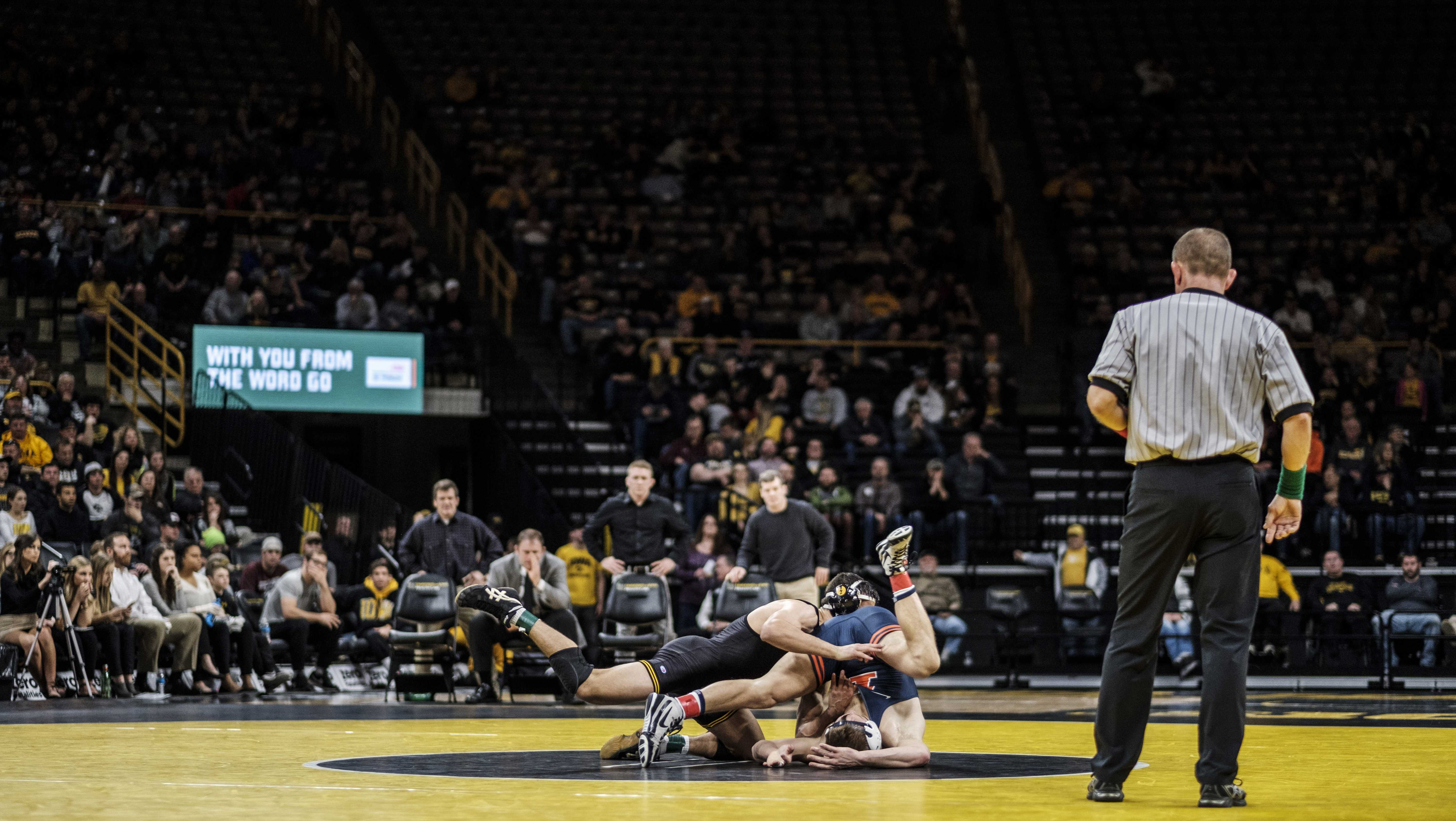 Iowa wrestler Michael Kemerer wrestles against Illinois' Kyle Langenderfer during a meet at Carver Hawkeye Arena on Friday, Dec. 1, 2017. The Hawkeyes defeated the Illini 18-17. (Nick Rohlman/The Daily Iowan)