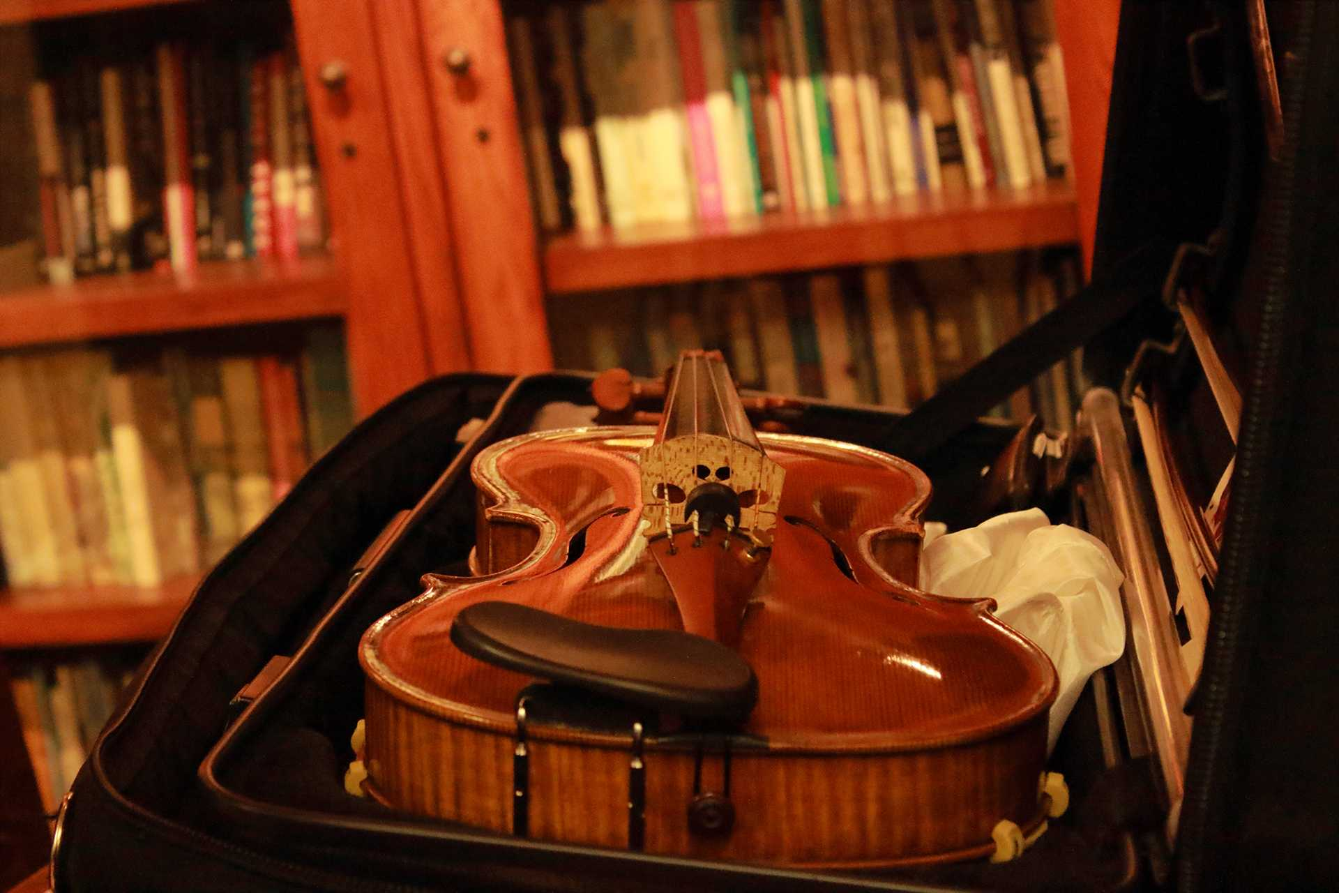 A violin sits before the program in the Frank Conroy Reading Room of the Dey House on Thursday, Oct. 5, 2017. (Ashley Morris/The Daily Iowan)