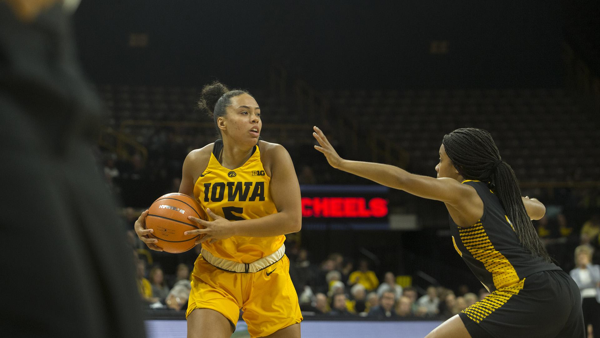 Iowa guard Alexis Sevillian holds the ball during the Iowa/Arkansas-Pine Bluff basketball game in Carver-Hawkeye Arena on Saturday, Dec. 9, 2017. The Hawkeyes defeated the Golden Lions, 85-45. (Lily Smith/The Daily Iowan)