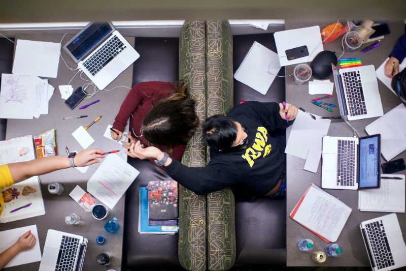 Students are seen studying on the first floor of the UI Main Library on Sunday, Dec. 10, 2017.