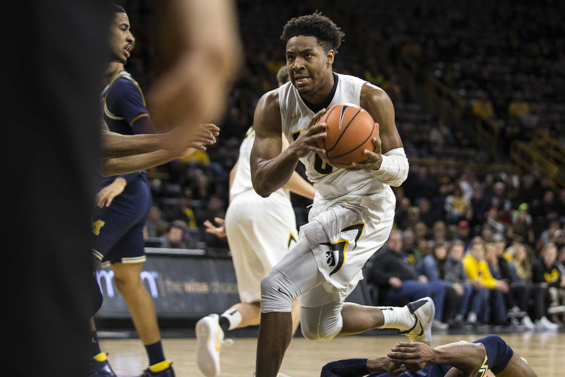 Iowa forward Ahmad Wagner (0) drives the ball to the hoop over Michigan's M-A Abdur-Rahkman (12) during the NCAA basketball game between Iowa and Michigan at Carver-Hawkeye Arena on Tuesday, Jan. 2, 2017. The Hawkeyes fell to the Wolverines 75-68. (Ben Allan Smith/The Daily Iowan)