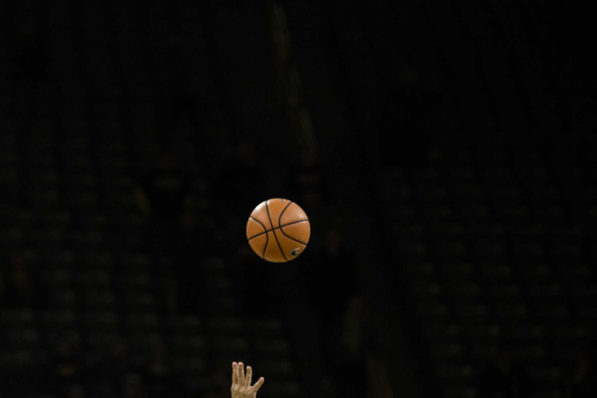 The referee throws the ball into the air during tip-off of the NCAA basketball game between Iowa and Michigan at Carver-Hawkeye Arena on Tuesday, Jan. 2, 2017. The Hawkeyes fell to the Wolverines 75-68. (Ben Allan Smith/The Daily Iowan)
