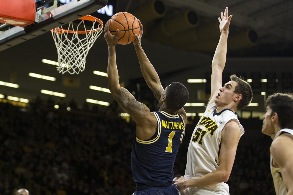 Michigan+guard+Charles+Matthews+%281%29+dunks+the+ball+in+front+of+Iowa%27s+Nicholas+Baer+%2851%29+during+the+NCAA+basketball+game+between+Iowa+and+Michigan+at+Carver-Hawkeye+Arena+on+Tuesday%2C+Jan.+2%2C+2017.+The+Hawkeyes+fell+to+the+Wolverines+75-68.+%28Ben+Allan+Smith%2FThe+Daily+Iowan%29