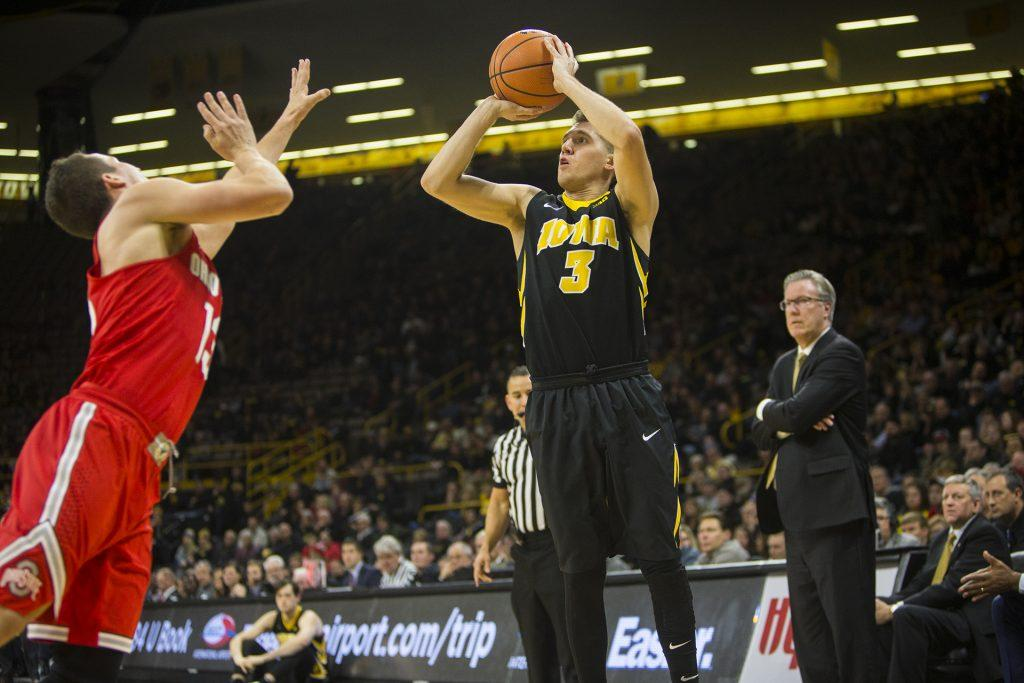 Iowa+guard+Jordan+Bohannon+shoots+a+3+while+being+covered+by+Ohio+State+guard+Andrew+Dakich+during+an+Iowa%2FOhio+State+men%27s+basketball+game+in+Carver-Hawkeye+Arena+on+Thursday%2C+Jan.+4%2C+2018.+