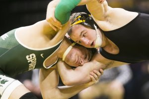 Iowa's No. 14 165-pound Alex Marinelli wrestles Michigan State's Austin Hiles during an Iowa/Michigan State wrestling matchup in Carver-Hawkeye Arena on Friday, Jan. 5, 2018. Marinelli scored a tech. fall over Hiles, 23-5. (Joseph Cress/The Daily Iowan)