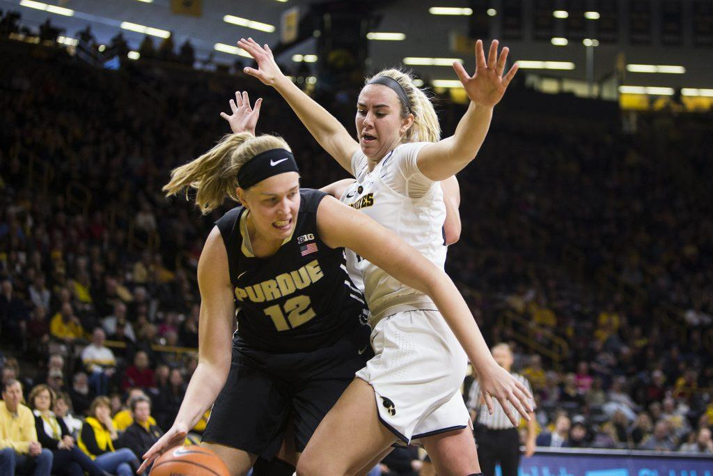 Purdue+center+Nora+Kiesler+dribbles+past+Iowa+forward+Hannah+Stewart+during+an+Iowa%2FPurdue+women%27s+basketball+game+in+Carver-Hawkeye+Arena+on+Saturday%2C+Jan.+13%2C+2018.+The+Boilermakers+defeated+the+Hawkeyes%2C+76-70.+%28Joseph+Cress%2FThe+Daily+Iowan%29