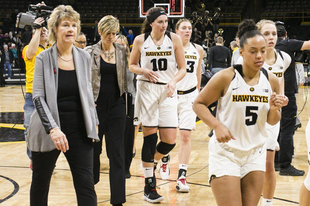 Iowa+head+coach+Lisa+Bluder%2C+associate+Jan+Jensen%2C+Megan+Gustafson%2C+Amanda+Ollinger%2C+Alexis+Sevillian%2C+Kathleen+Doyle+and+Carly+Mohns+walk+off+the+court+after+an+Iowa%2FPurdue+women%27s+basketball+game+in+Carver-Hawkeye+Arena+on+Saturday%2C+Jan.+13%2C+2018.+