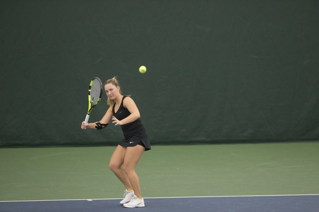 Iowa%27s+Danielle+Burich+readies+a+forehand+during+a+tennis+match+between+Iowa+and+Northern+Iowa+in+Iowa+City+on+Saturday%2C+Jan.+20%2C+2018.+The+Hawkeyes+defeated+the+Panthers%2C+7-0.+%28Shivansh+Ahuja%2FThe+Daily+Iowan%29