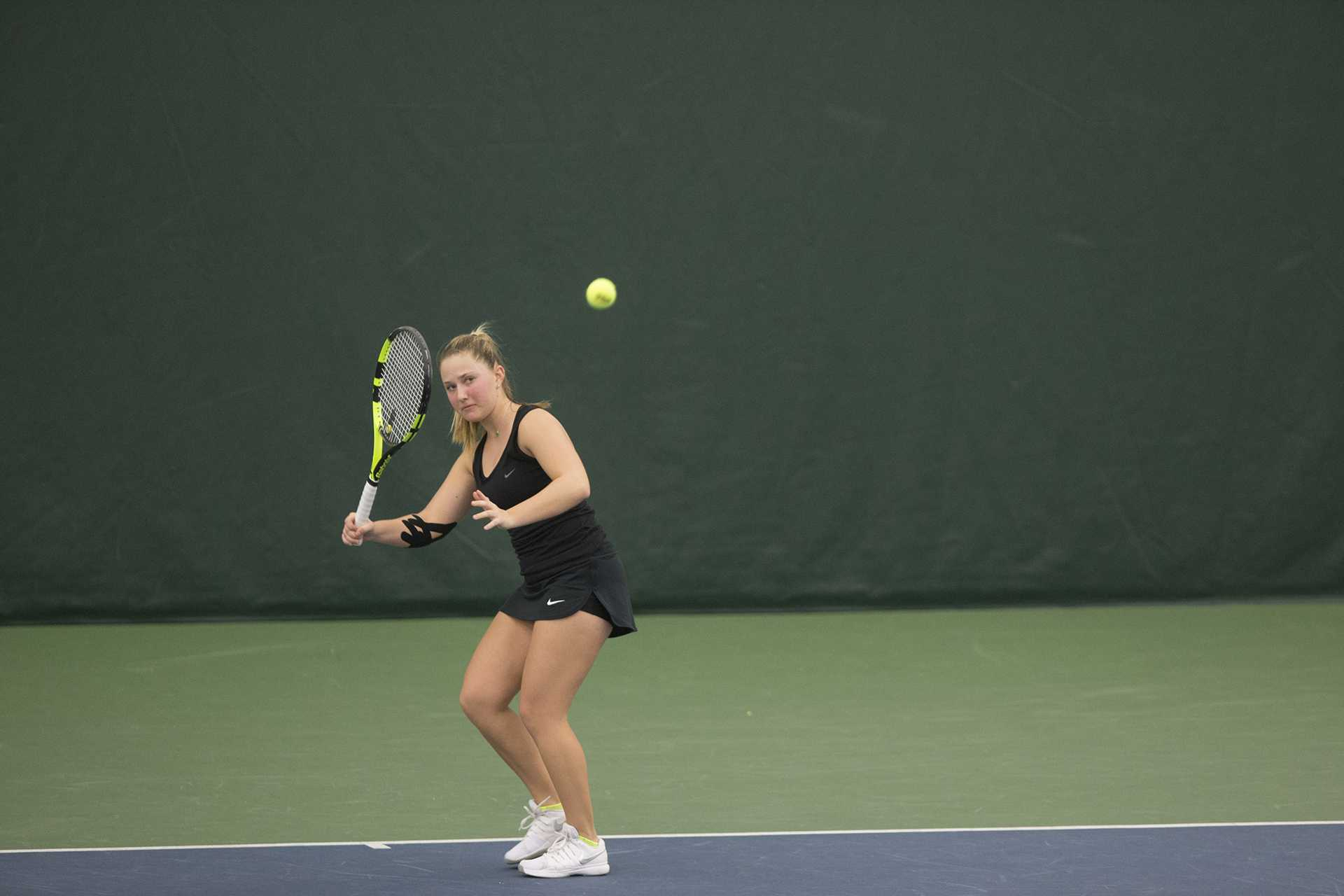 Iowa's Danielle Burich readies a forehand during a tennis match between Iowa and Northern Iowa in Iowa City on Saturday, Jan. 20, 2018. The Hawkeyes defeated the Panthers, 7-0. (Shivansh Ahuja/The Daily Iowan)