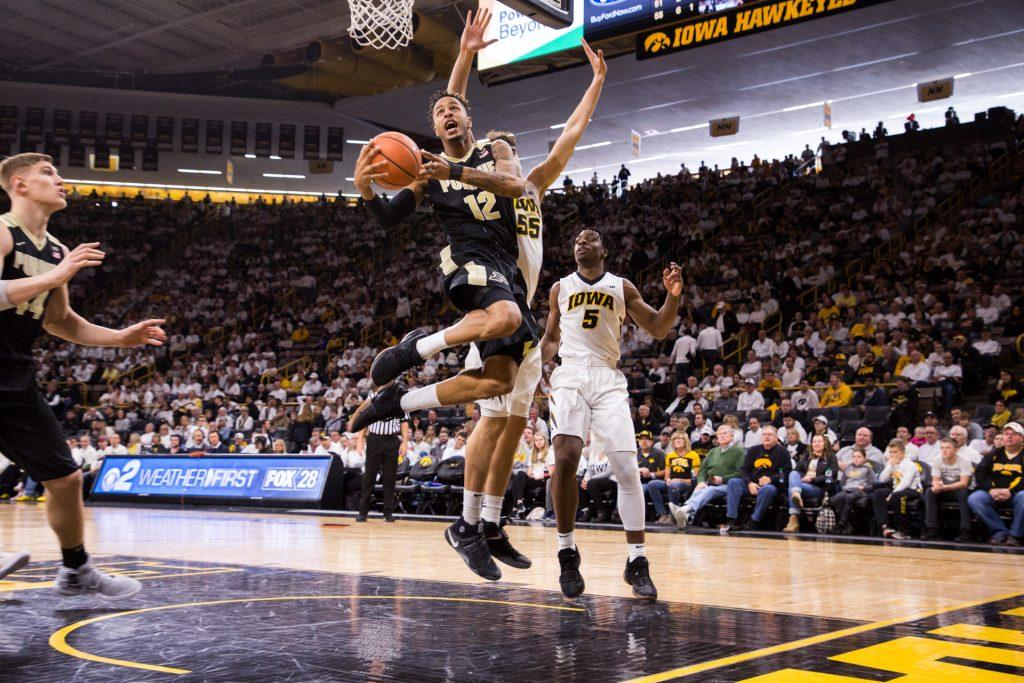 Purdue+forward+Vincent+Edwards+twists+as+he+elevates+towards+the+basket+during+a+game+against+the+University+of+Iowa+on+Saturday%2C+Jan.+20%2C+2018.+The+Boilermakers+defeated+the+Hawkeyes+87-64.+%28David+Harmantas%2FThe+Daily+Iowan%29