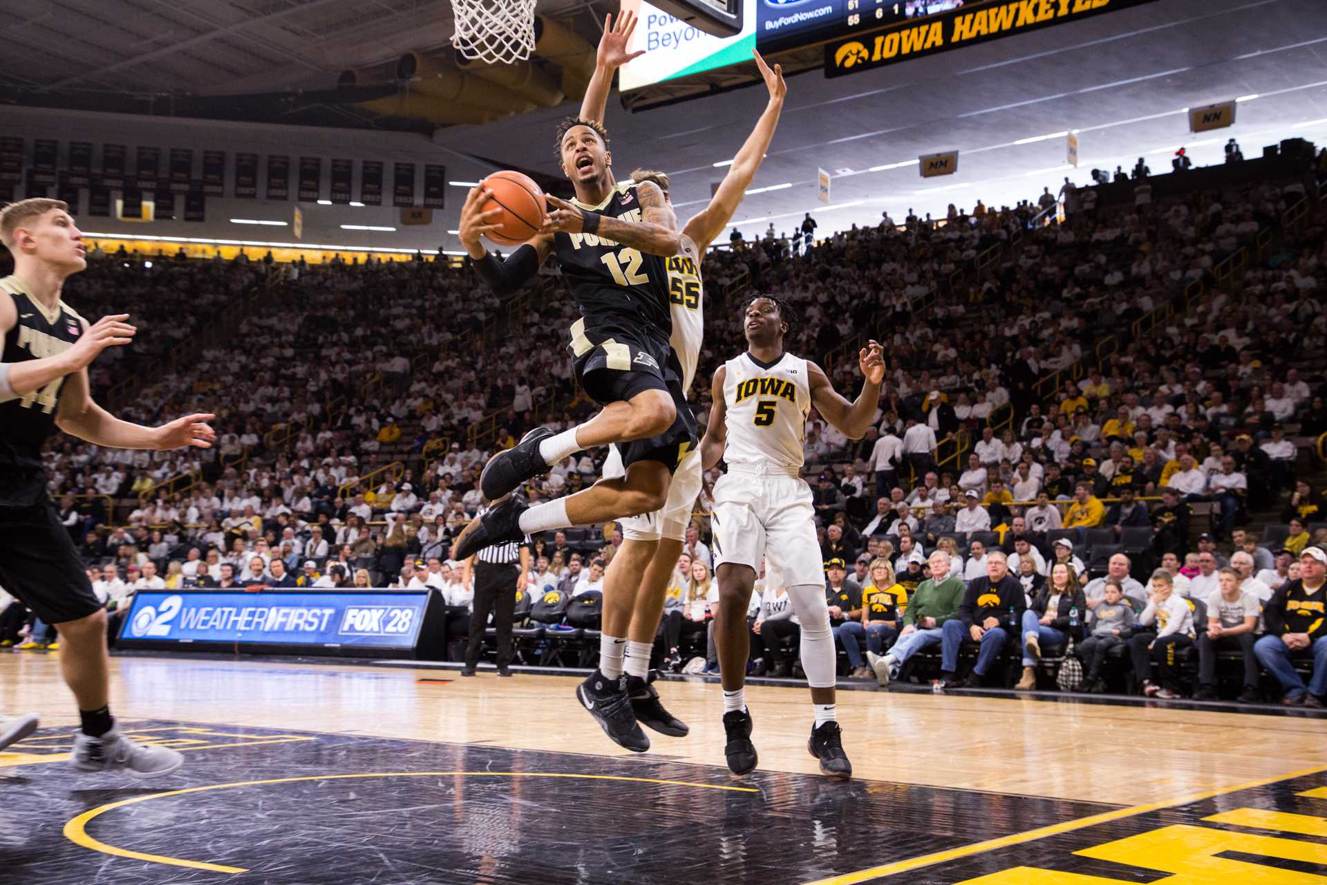 Purdue forward Vincent Edwards twists as he elevates towards the basket during a game against the University of Iowa on Saturday, Jan. 20, 2018. The Boilermakers defeated the Hawkeyes 87-64. (David Harmantas/The Daily Iowan)