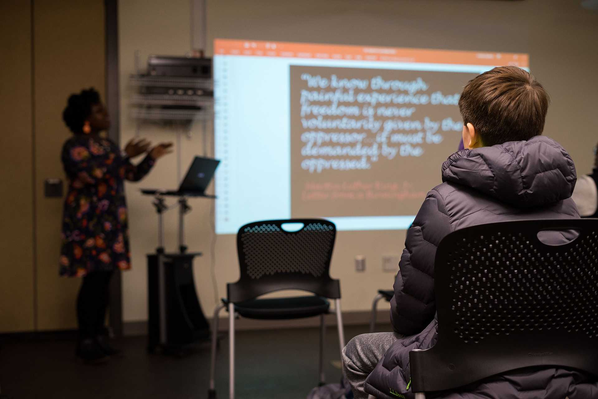 A young boy listens to a speaker at a presentation on the history of civil rights in Iowa on Thursday, Jan. 25, 2018. This event was put on by the African American Museum of Iowa. (Matthew Finley/The Daily Iowan)