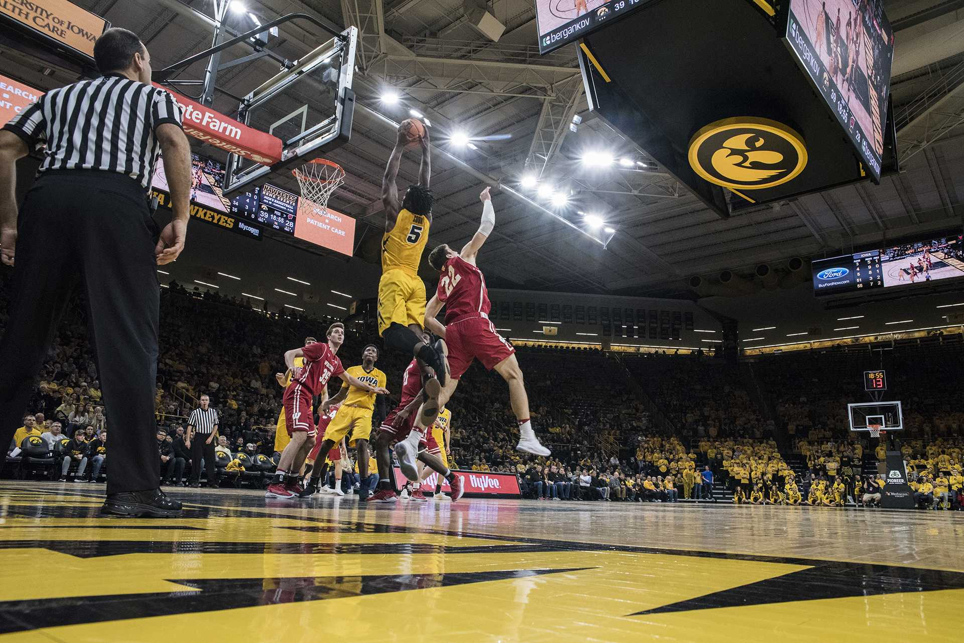 Iowa forward Tyler Cook (5) dunks the ball over Wisconsin's Ethan Happ (22) during the NCAA men's basketball game between Iowa and Wisconsin at Carver-Hawkeye Arena on Tuesday, Jan. 23, 2018. The Hawkeyes are going into the game with a conference record of 1-7. Iowa went on to defeat Wisconsin 85-67. (Ben Allan Smith/The Daily Iowan)