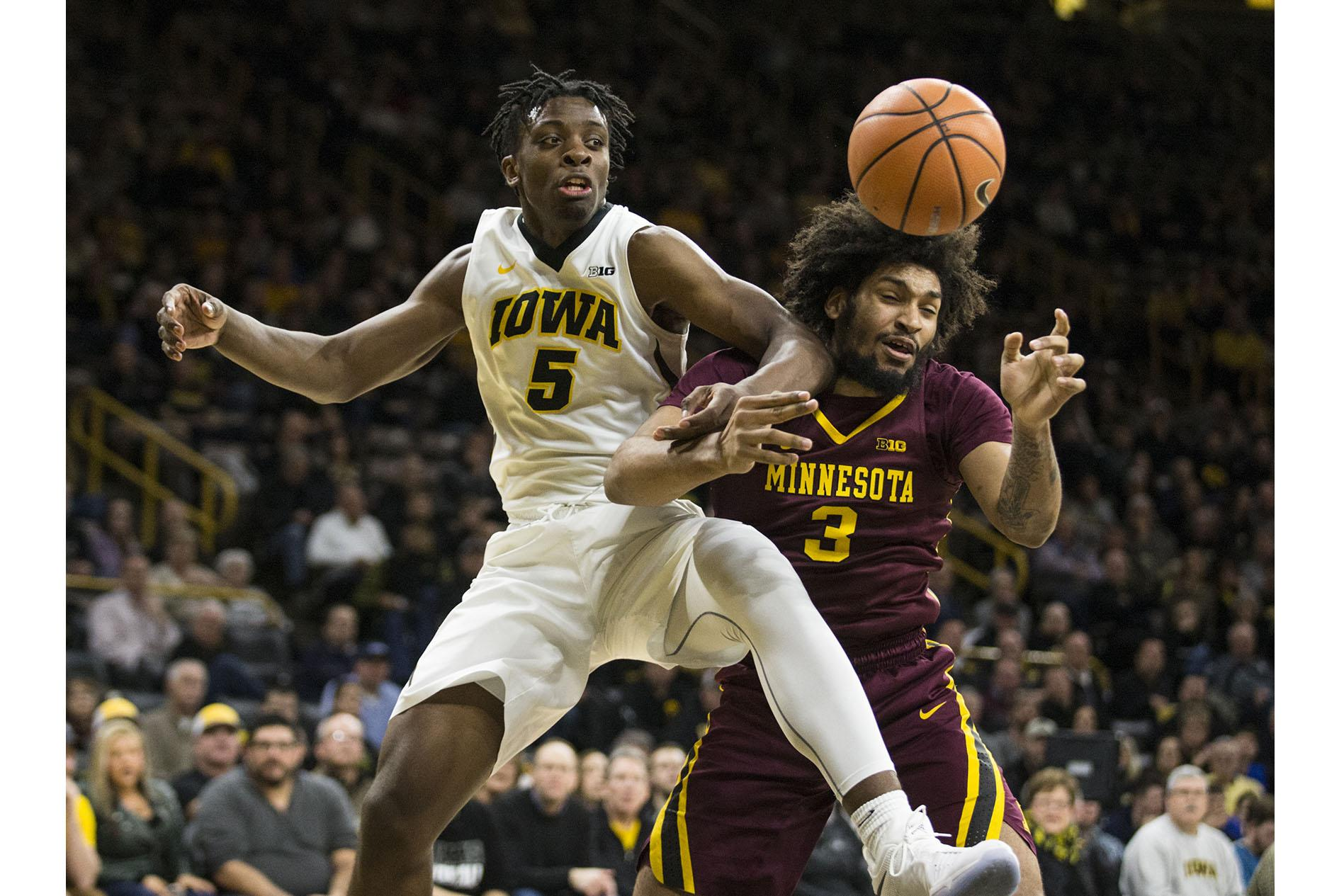 Iowa's Tyler Cook (5) and Minnesota's Jordan Murphy (3) go for a loose ball during the NCAA men's basketball game between Iowa and Minnesota at Carver-Hawkeye Arena on Tuesday, Jan. 30, 2018. The Hawkeyes are going into the game with a Big Ten conference record of 2-8. Iowa went on to defeat the Golden Gophers 94-80. (Ben Allan Smith/The Daily Iowan)