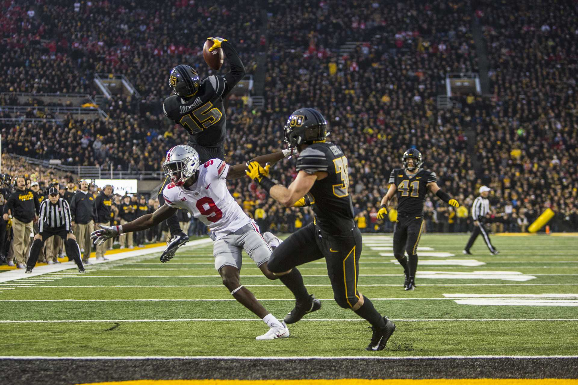 Iowa cornerback Josh Jackson makes a jumping one handed interception during Iowa's game against Ohio State at Kinnick Stadium on Saturday, Nov. 4, 2017. Jackson made three interceptions on the day as the Hawkeyes defeated the Buckeyes, 55-24. (Nick Rohlman/The Daily Iowan)