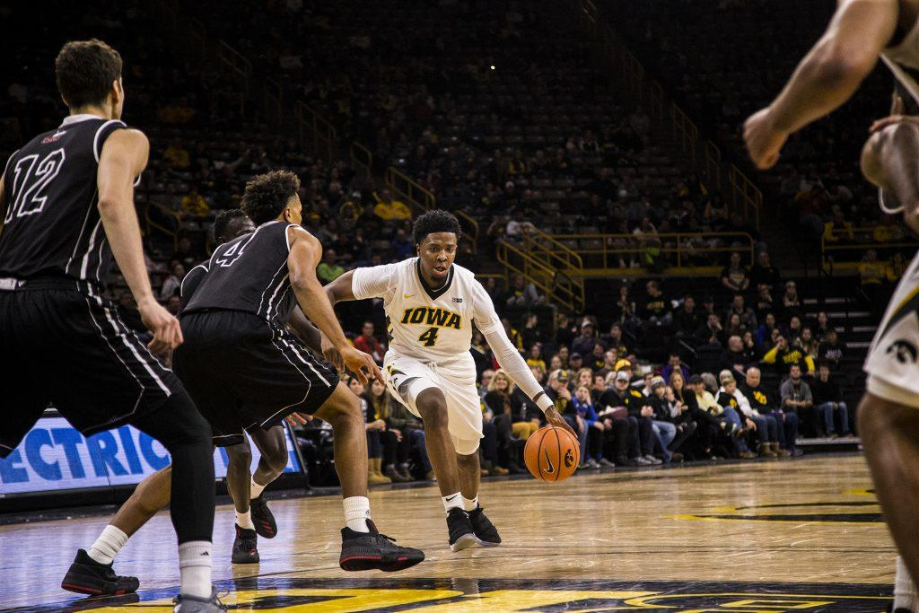 Iowa+guard+Isiah+Moss+drives+the+ball+during+Iowa%27s+game+against+Northern+Illinois+on+Friday+Dec.+29%2C+2017.+The+Hawkeyes+defeated+the+Huskies+98+to+75.+%28Nick+Rohlman%2FThe+Daily+Iowan%29