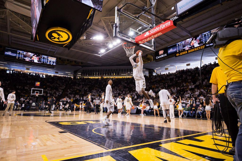 Players+warm+up+in+Carver-Hawkeye+Arena+before+a+basketball+game+against+Purdue+University+on+Saturday%2C+Jan.+20%2C+2018.+The+Boilermakers+defeated+the+Hawkeyes+87-64.+%28David+Harmantas%2FThe+Daily+Iowan%29