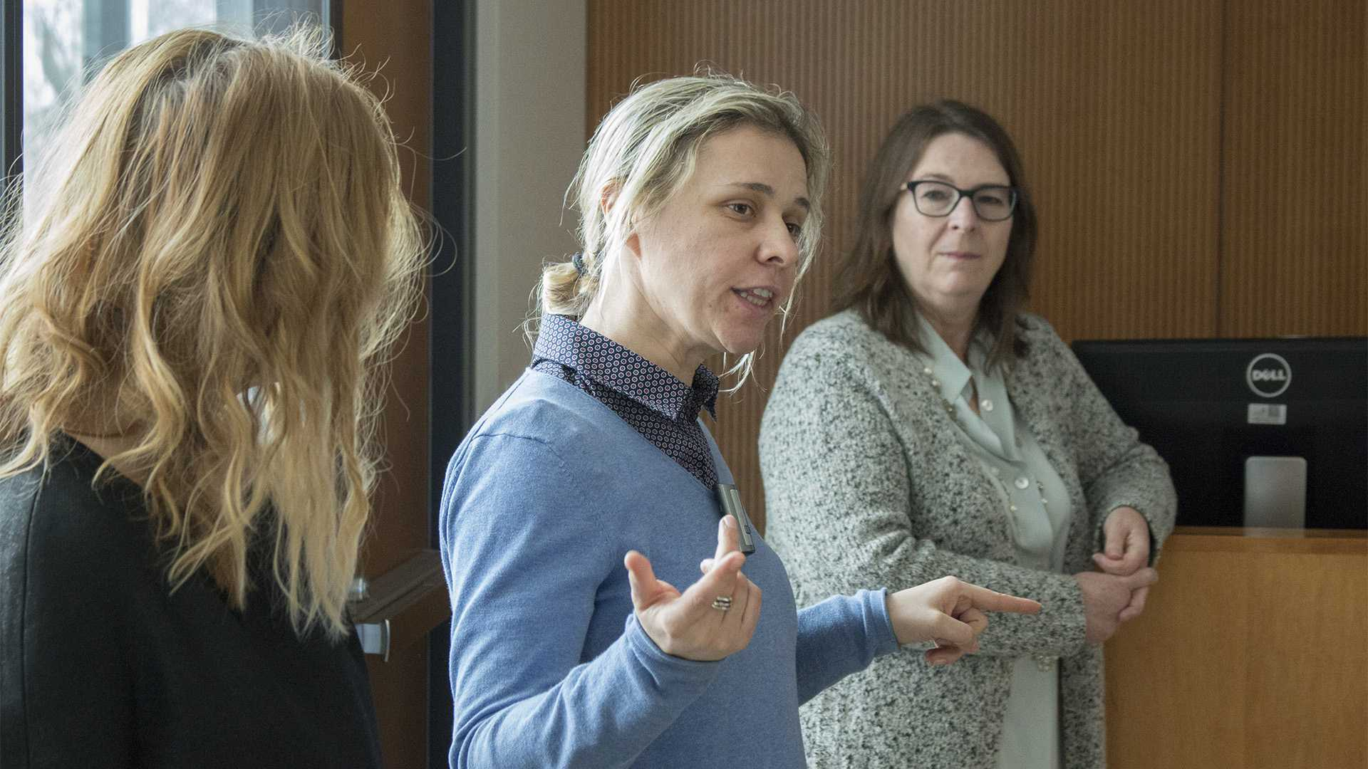 Photographer Majda Turkic (center) answers a question during a presentation in the College of Public Health on Wednesday, Jan. 31, 2018. The college hosted a workshop on cyberbullying and social media use internationally. (Shivansh Ahuja/The Daily Iowan)