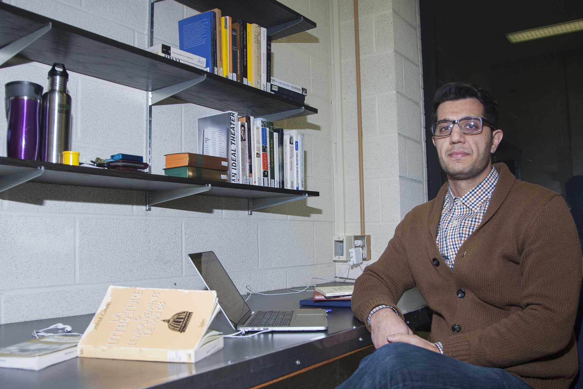 UI grad student Farzad Salamifar poses for a portrait in the Main Library on Wednesday, Jan. 24, 2018. Salamifar is an Iranian immigrant at the University of Iowa on a student visa. (Lily Smith/The Daily Iowan)