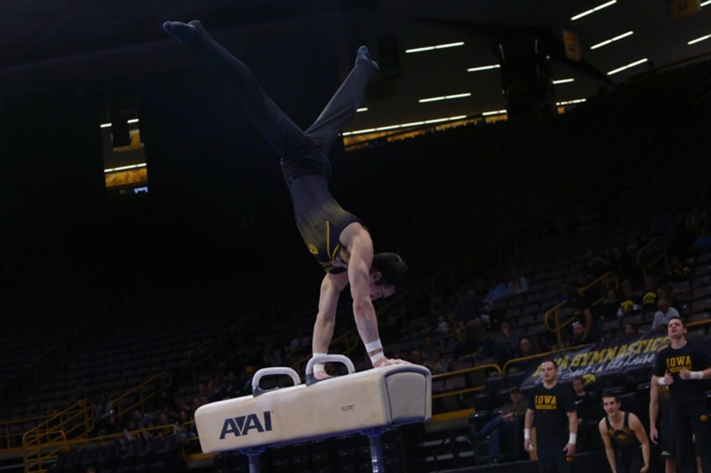 Iowa gymnast Austin Hodges preforms on the pommel horse during the Iowa-Nebraska match at Carver-Hawkeye Arena on Monday, March 20, 2017. The Hawkeyes defeated the Huskers, 408.300-400.000. (The Daily Iowan/Margaret Kispert)