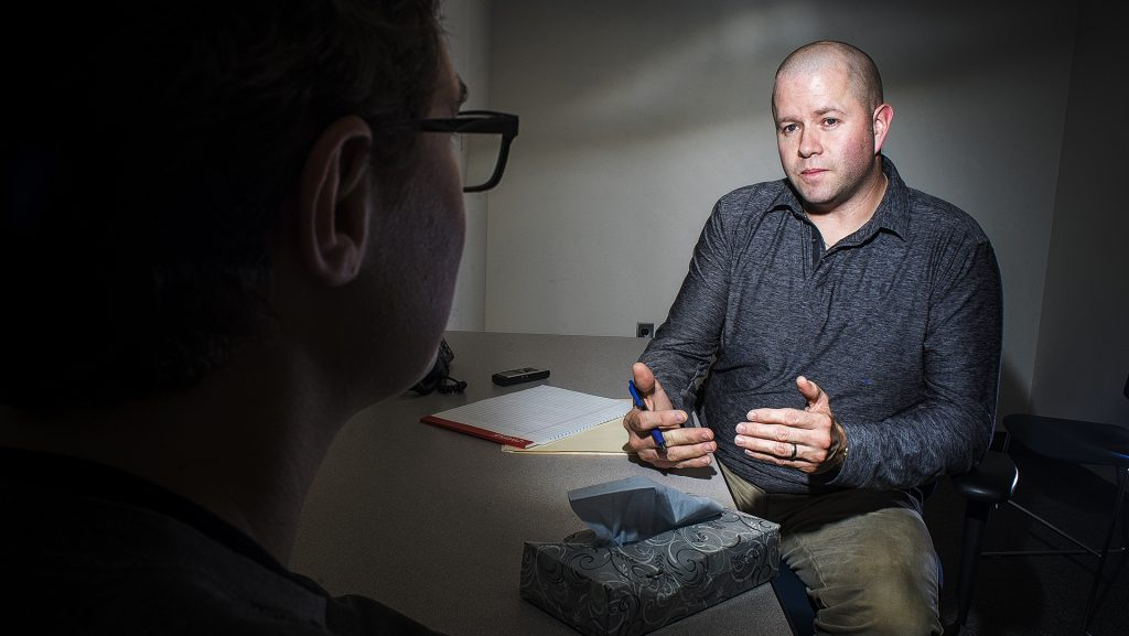 ICPD investigator Scott Stevens conducts a mock interview with a DI reporter for a photo illustration on Tuesday, Jan. 23, 2017. The ICPD was just awarded a 450,000 dollar grant to help fight domestic and sexual assault. (James Year/ The Daily Iowan)